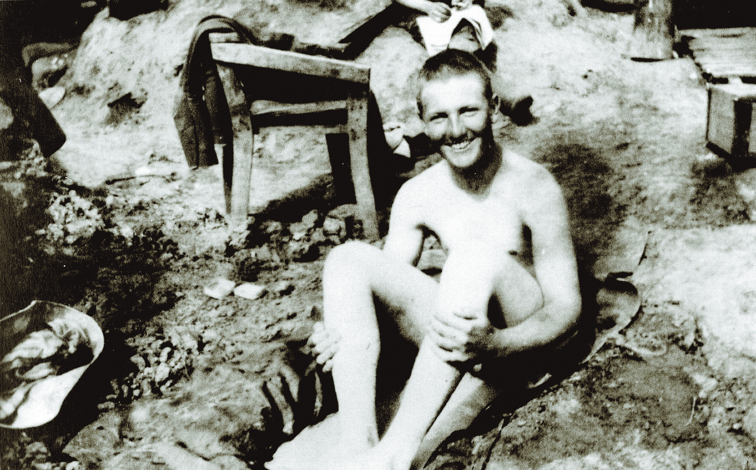 Life in the trenches was indescribably dirty and dangerous. Most of the time at the front was spent in muddy, cold wet trenches.. This delightful shot of a bather indicates that morale could be high at times, especially during periods of little gunfire. In the background, a fellow soldier is seen reading a trench newspaper. (Canadian War Museum, 19780093-0140)