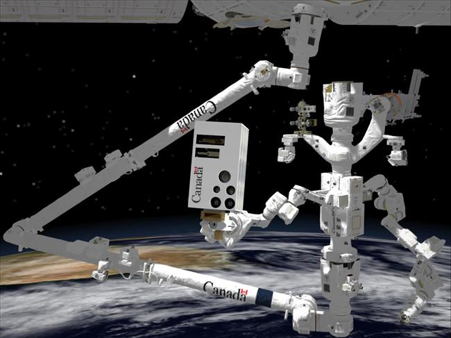 Showing Dextre on the right held by Canadarm2 and holding the vision system (www.asc-csa.gc.ca).