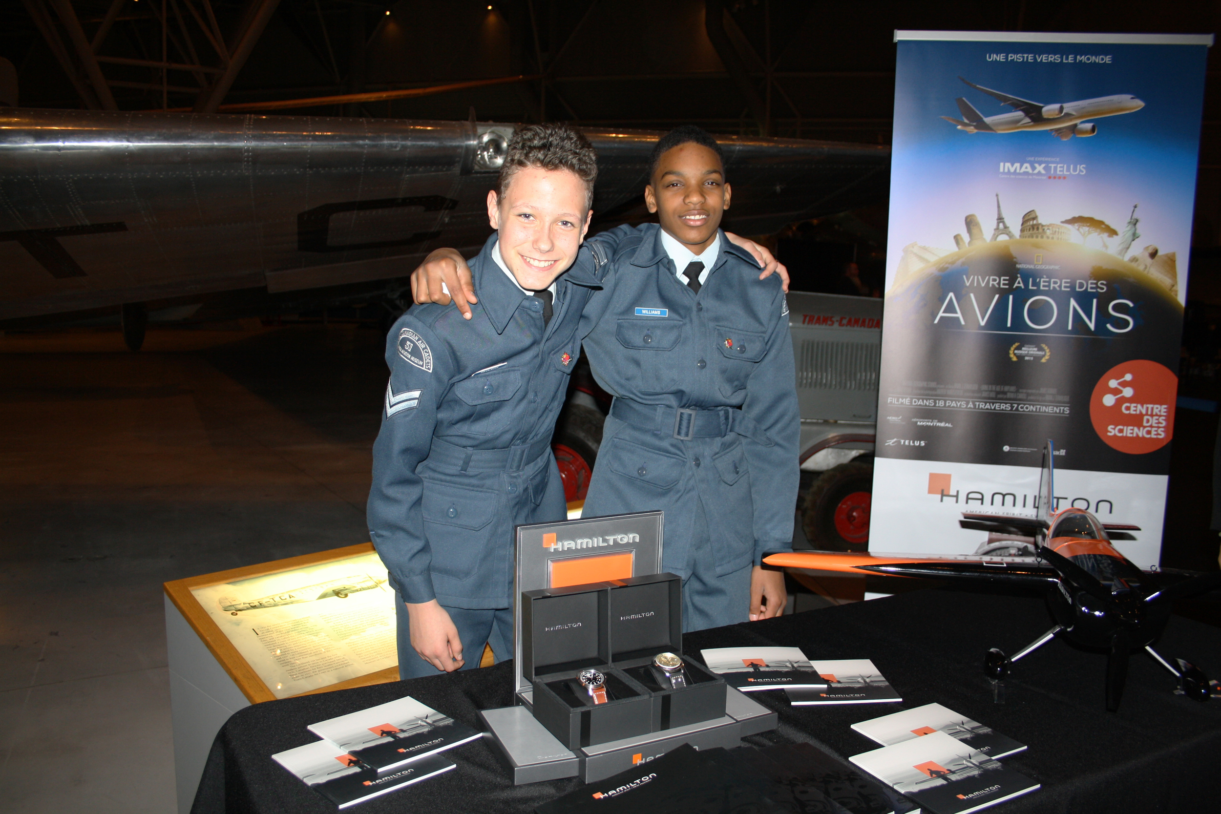 Hamilton Watches, the official timekeeper of the Air Cadet League of Canada, provides each year watches to the 2 top air cadet pilots. Many Air Cadets, like the two young men in the photo, provided their help that evening. (Sitraka Raoelimanohisoa)