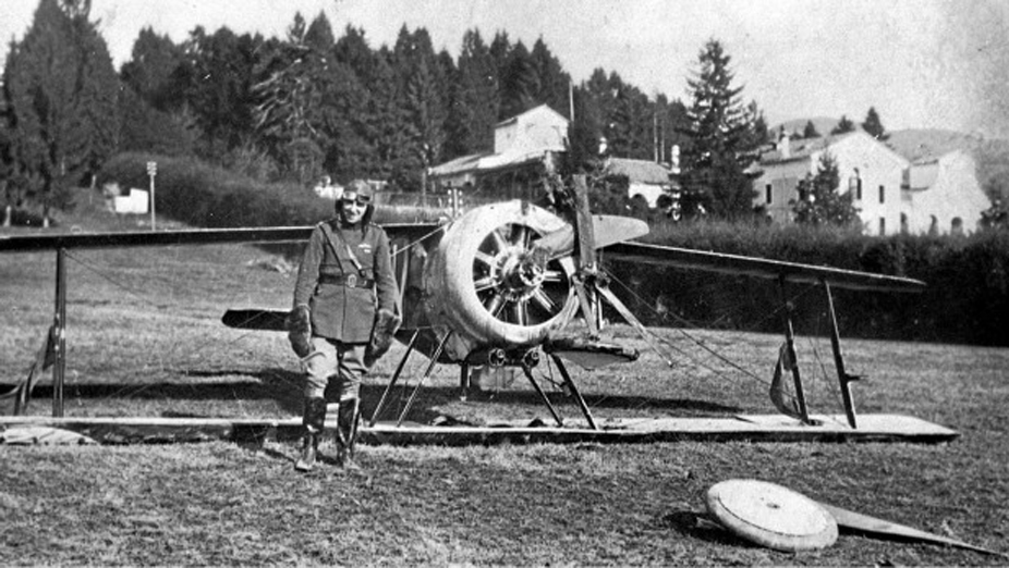 Captain William G. Barker strikes a somewhat sheepish pose after crashlanding his Sopwith Camel B6313 'N' of No. 28 Squadron, Royal Flying Corps, near Grossa aerodrome in Italy. B6313 was soon repaired and flying again, with Barker scoring 43 of his 50 victories flying it. (LIBRARY AND ARCHIVES CANADA, 3623376)