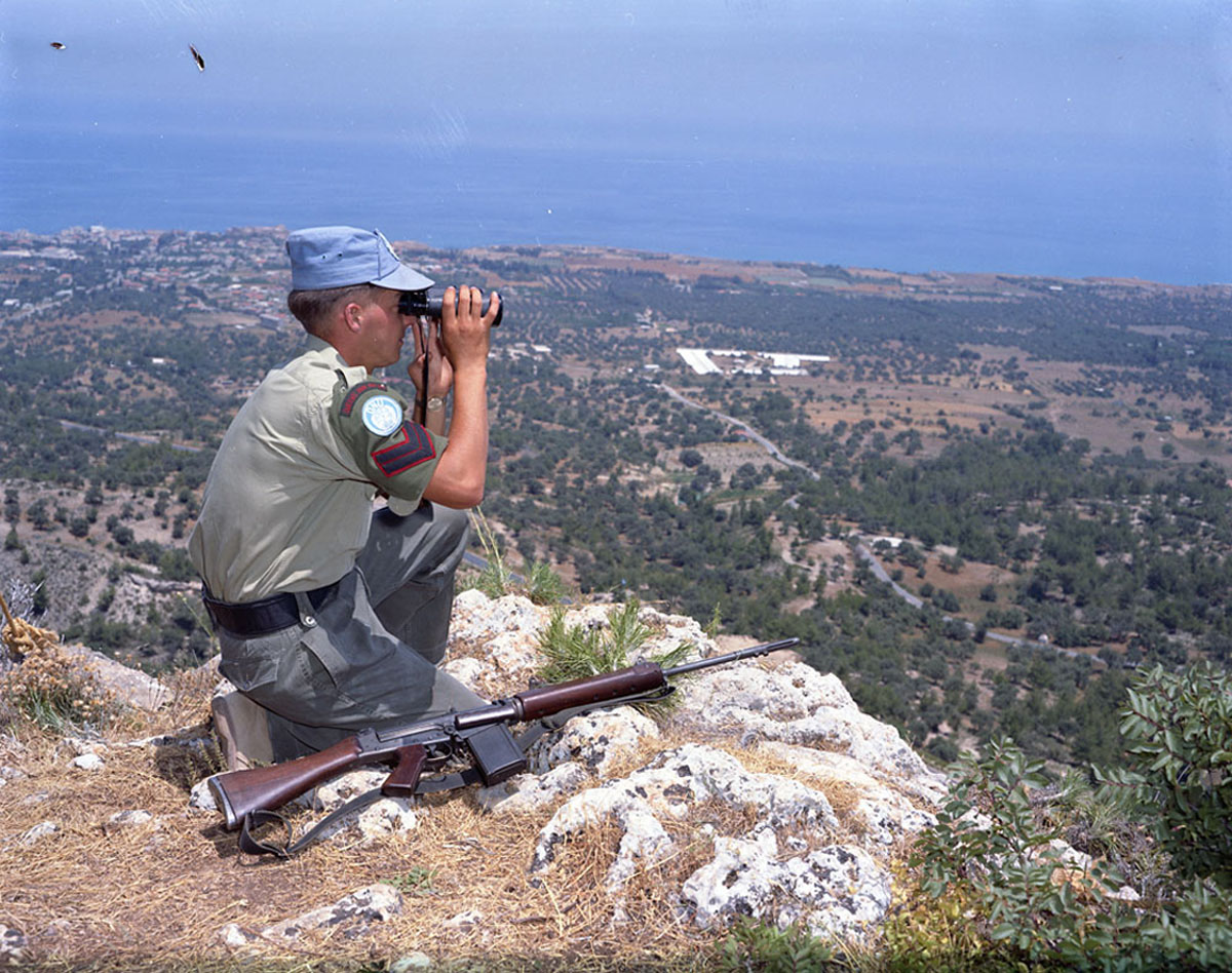 A member of the Royal Canadian Dragoons Reconnaissance Squadron, deployed as part of the United Nations Peacekeeping Force in Cyprus (UNFICYP), during a patrol. Canadian Armed Forces members have been deployed as a peacekeeping force since 1963. (DND, Library and Archives Canada)