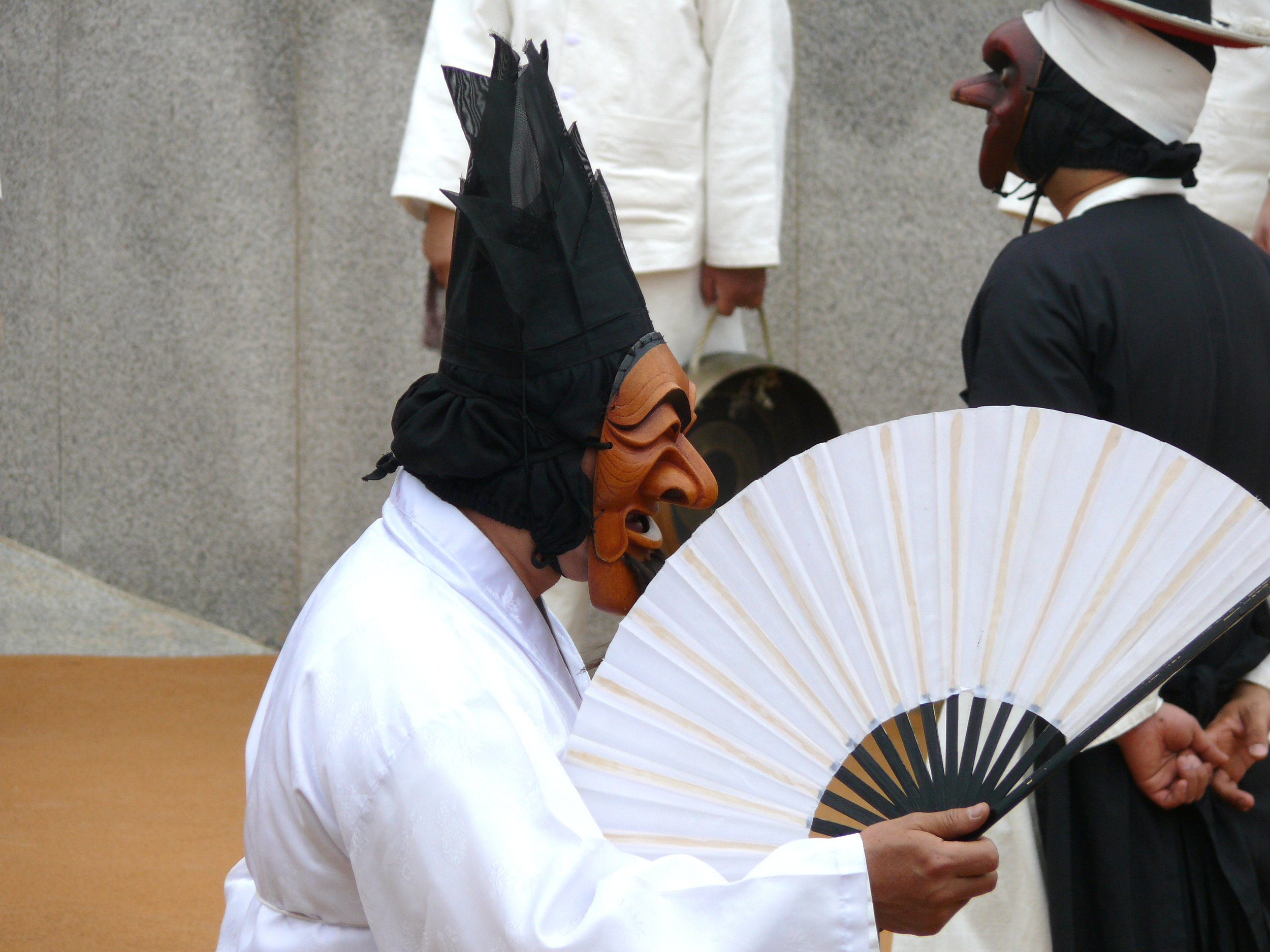 Actors perform in the carved wooden masks at the Andong open air theatre.