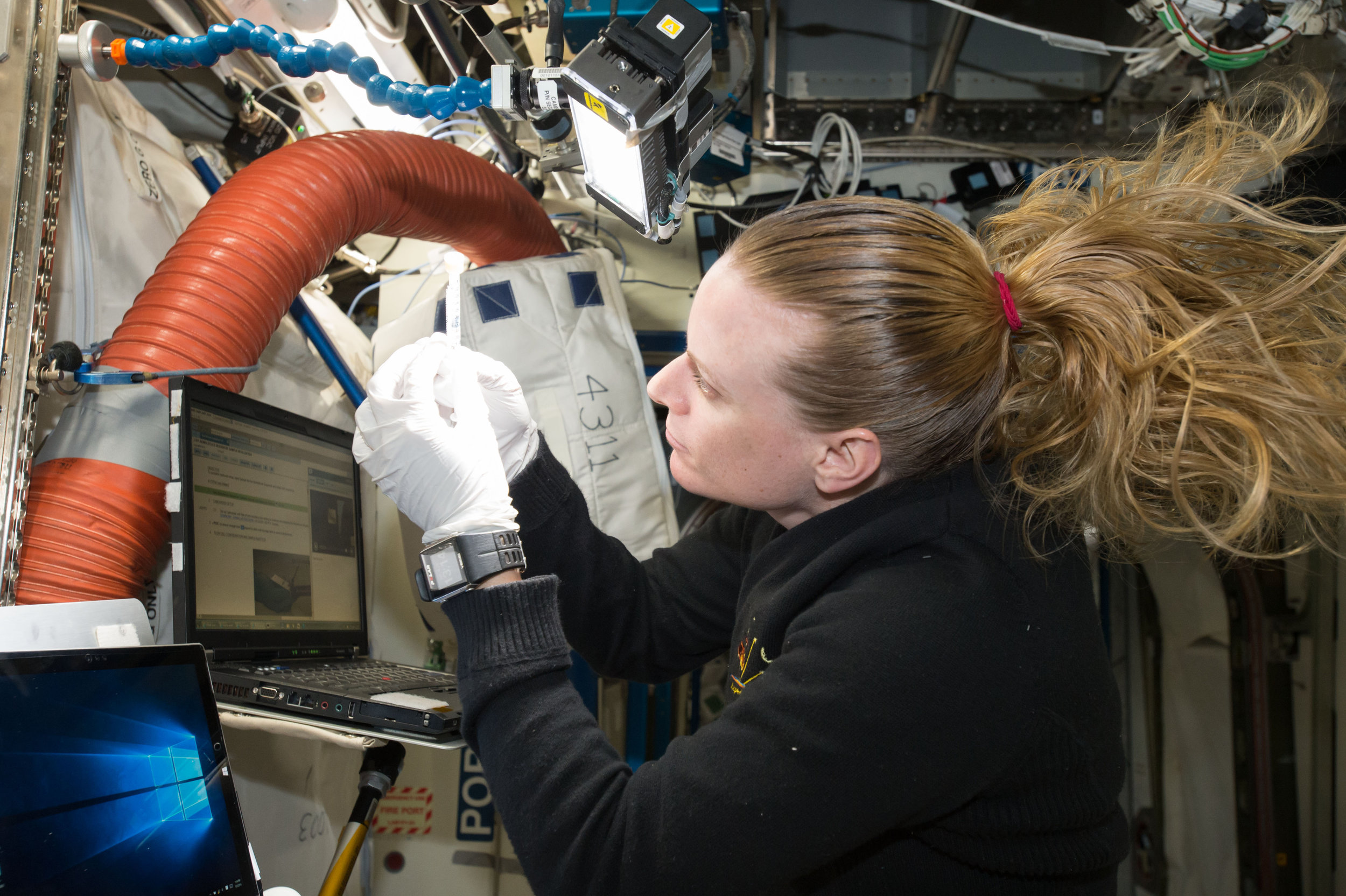 Aboard the International Space Station, NASA astronaut Kate Rubins checks a sample for air bubbles prior to loading it in the biomolecule sequencer.When Rubins' expedition began, zero base pairs of DNA had been sequenced in space. Within just a few weeks, she and the Biomolecule Sequencer team had sequenced their  one billionth base of DNA on the orbiting laboratory .