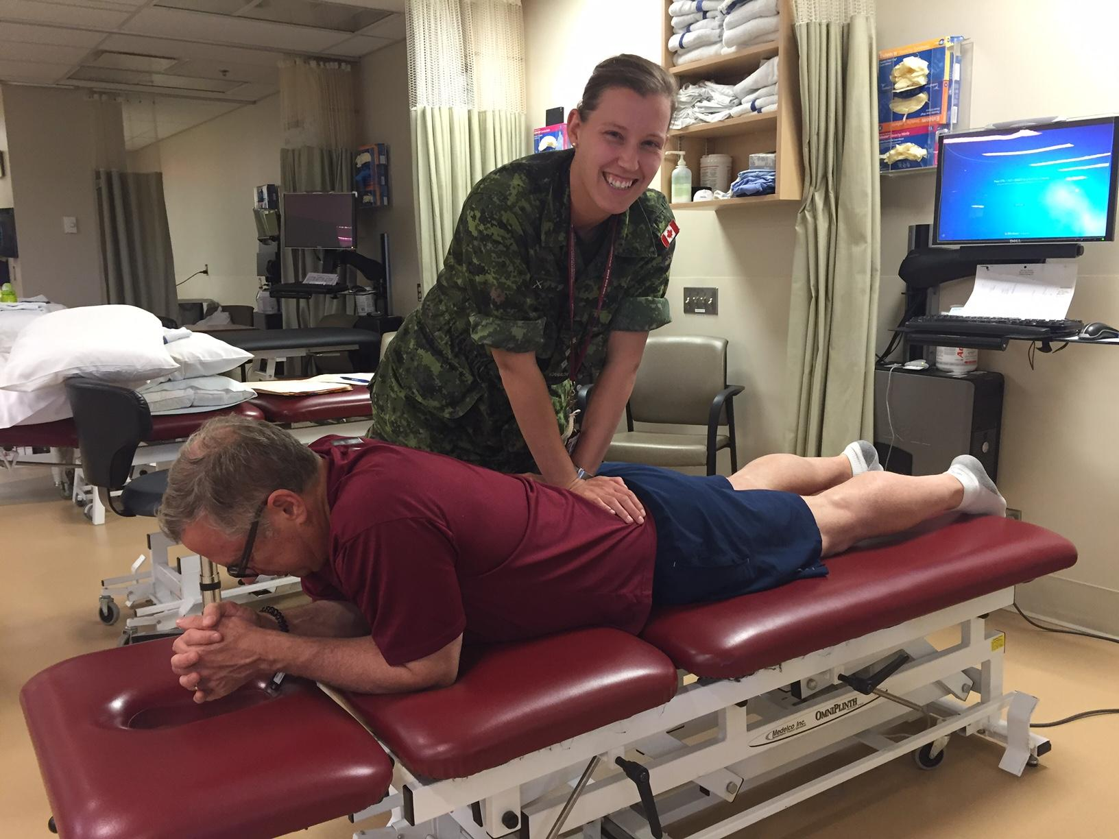 Captain Carole-Anne Dufour at work in the Canadian Forces Health Services Centre, Ottawa. Capt Dufour says her work as a Physiotherapy Officer is never dull. Photo provided by: Captain Carole-Anne Dufour