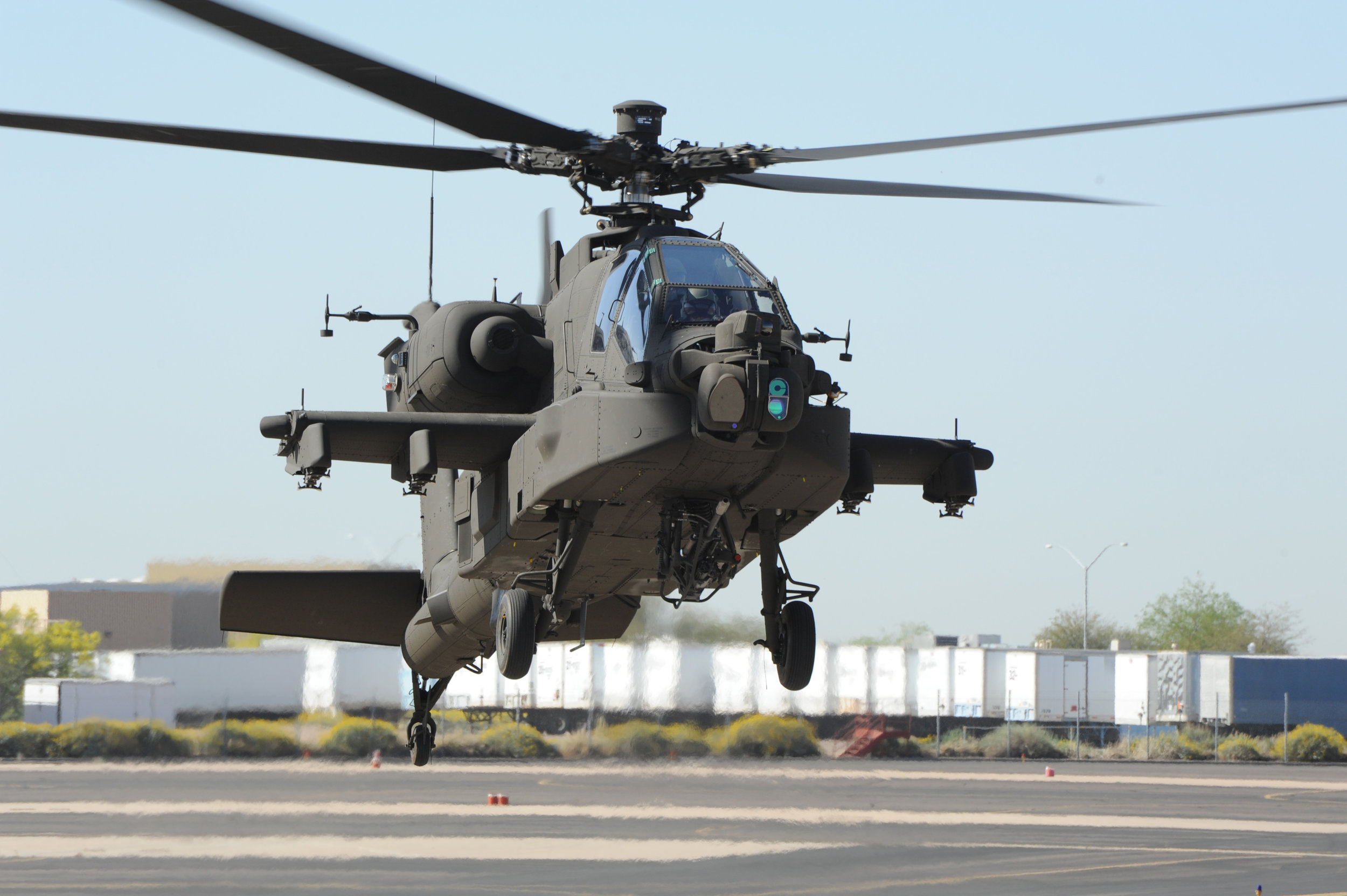 An upgraded Apache helicopter conducts a test flight at Boeing's production facility at Mesa, Arizona.