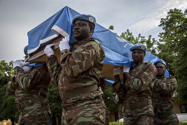 Peacekeepers from Benin attend the memorial ceremony held in honor of one peacekeeper from Burkina Faso   Photo Credit:https://www.flickr.com/photos/minusma/