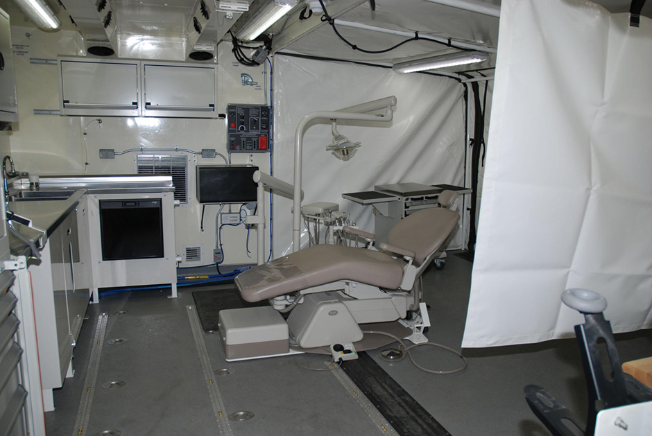 "Inside a fully equipped CAF mobile dental clinic — a mobile workspace or ""kitted shelter"" converted by DEW Engineering."