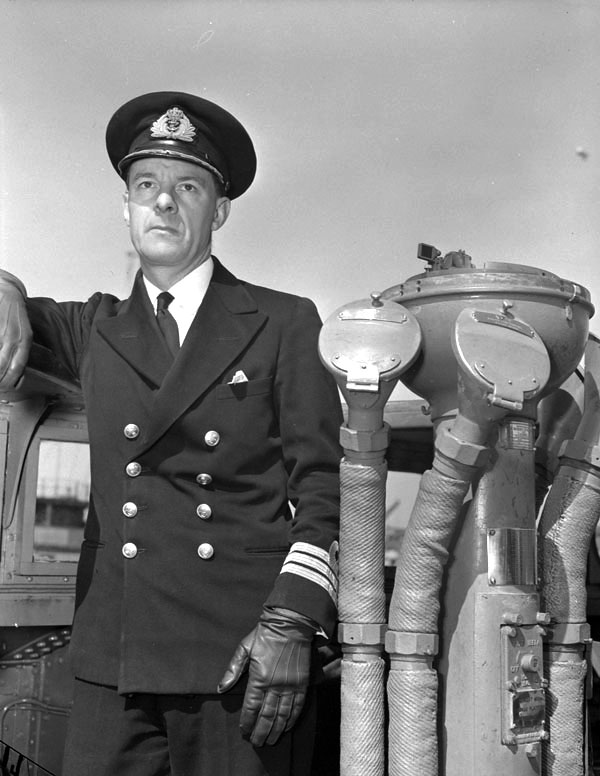 Commander Henry 'Hard About Harry' DeWolf stands on the bridge of the Tribal-class destroyer HMCS Haida, May 5, 1944. Weeks earlier, as the vessel's commanding officer, he was awarded the Distinguished Service Order (DSO) for Haida's sinking of German Torpedo boat T-27 and her heroic role in lingering to rescue survivors of its sister ship, HMCS Athabaskan. (po guy goulet, dnd, library and archives canada, pa-  134298  )