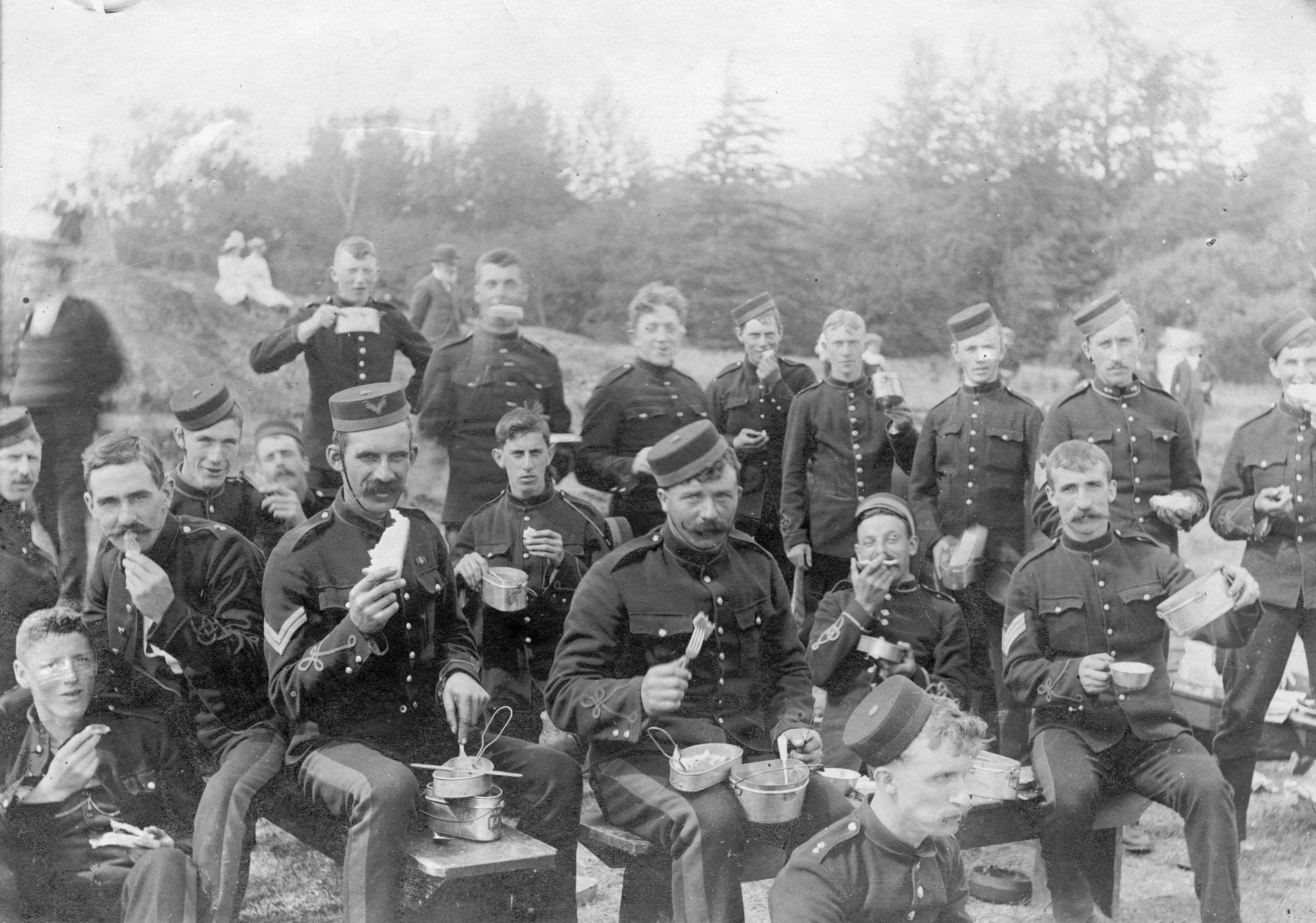 This photograph shows men from the 5th Regiment Canadian Garrison Artillery, Victoria, and the 6th Regiment The Duke of Connaught's Own Rifles of Vancouver having an outdoor meal in camp at Macaulay Point, Victoria, circa 1900. In 1897, Currie joined the 'Dandy Fifth' as they were nicknamed. By 1908, his gunnery skills and aptitude led to his commanding the regiment. (major james matthews, city of Vancouver archives)