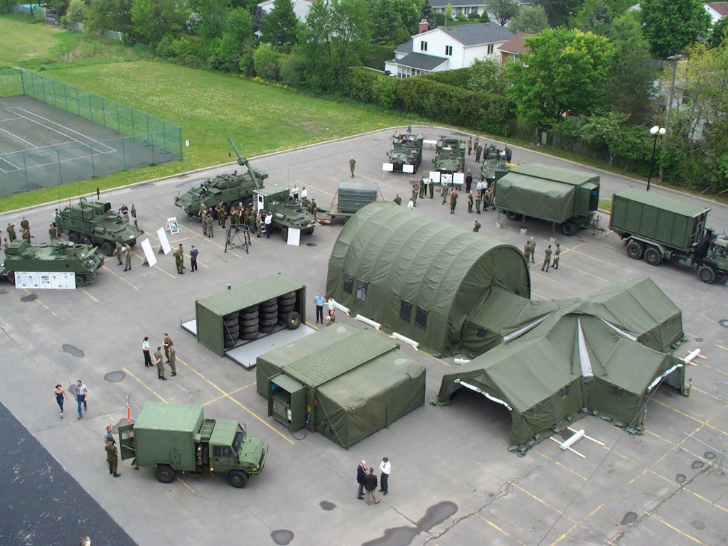 An aerial view of Weatherhaven's tactical tent-based shelter systems. On February 8, 2017 it was announced that the Coquitlam-based company won two contracts for tactical tent-based shelter systems. Weatherhaven uses a combination of fabric and expandable container technology to build portable shelters and camp systems. These new modular systems will replace the Canadian military's 1970s-era shelters. (weatherhaven)
