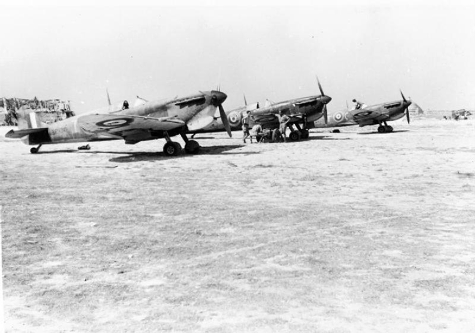 Supermarine Spitfire Mk. Vs of No. 249 Squadron RAF await their next scramble at Takali airfield in mid-1942. The Mk V was produced in greater numbers than any other single mark of Spitfire, and was also the first Spitfire to be used in large numbers outside Britain. The first such deployment came in March 1942, when 15 Mk VBs were delivered to Malta in an effort to hold off the Bf 109F, while Hurricanes were used to attack lower-level bombers. (  249  squadronraf@wordpress.com)