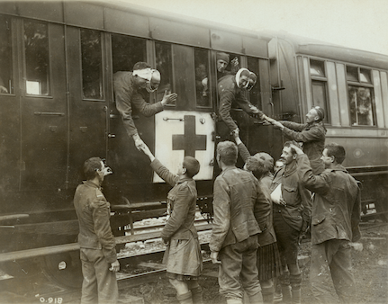 "On the way to Blighty. Wounded board a train on the way to England for further treatment and convalescence. Commonwealth soldiers described England as ""Blighty,"" and also used it to indicate the non-fatal wound that would take you there. (george metcalf archival collection, cwm     19920044-819    )"