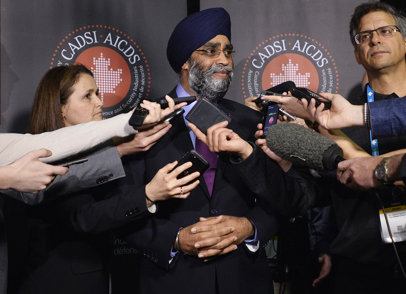 At CANSEC 2016, the Honourable Harjit Sajjan, Minister of National Defence, after presenting at CANSEC, revealed in a scrum with journalists — including Esprit de Corps' David Pugliese (far right) — the Liberal's proposal to purchase the Super Hornet fighter jets as the CF-18's interim replacement. This year, CANSEC attendees will no doubt be discussing what will be contained in the Liberal's defence review, which had yet to be released at time of press. (cadsi)