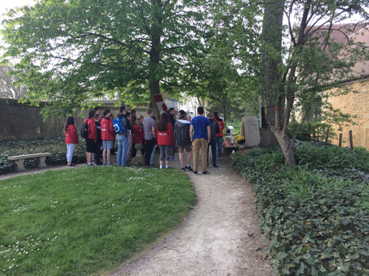 In the village of Villons-les-Buissons, students from Cole Harbour High School reflect in silence in the garden of the Abbaye d'Ardenne, where Canadian soldiers were executed by Kurt Meyer's 12th SS Panzer Division (the Hitler Youth) in the days and weeks following the D-Day landings. ABOVE LEFT: The plaque on the wall of the Abbaye is dedicated to the memory of the 27 executed Canadian prisoners of war.