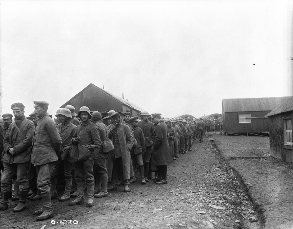 German prisoners captured by Canadians at Vimy Ridge in April 1917 are marched toward prisoner or war camps to the rear. Initial reports claimed Canadians captured almost 6,000 POWs in the fighting. (dnd, library and archives canada, pa-  001190  )