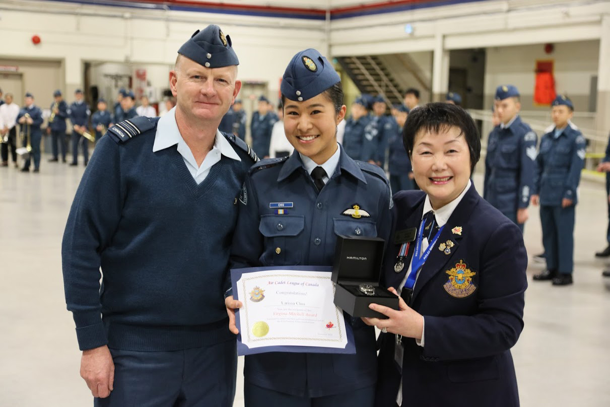 WO2 Larissa Chiu receiving the Virginia Mitchell Award. Presented by Greater Vancouver Wing Chair Sheila Kung and 111 Pegasus Commanding Officer Captain A. Smith.