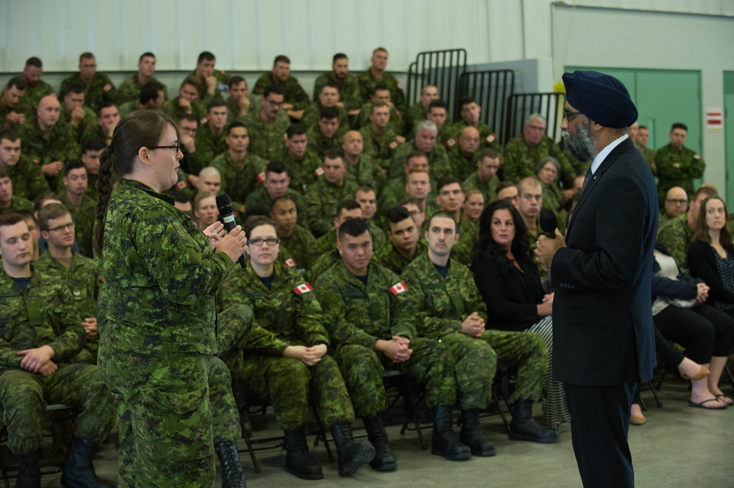 "Released on June 7, 2017, the Liberal government's defence policy review has devised a plan that is based on people — ""The women and men of the Canadian Armed Forces and the families that support them"" — and has a vision for the future — ""a Canada that is strong at home, secure in North America, and engaged in the world.""  Following the release of the document, Defence Minister Harjit Sajjan (above) travelled to bases across the country to answer questions from CAF members. (dnd)"