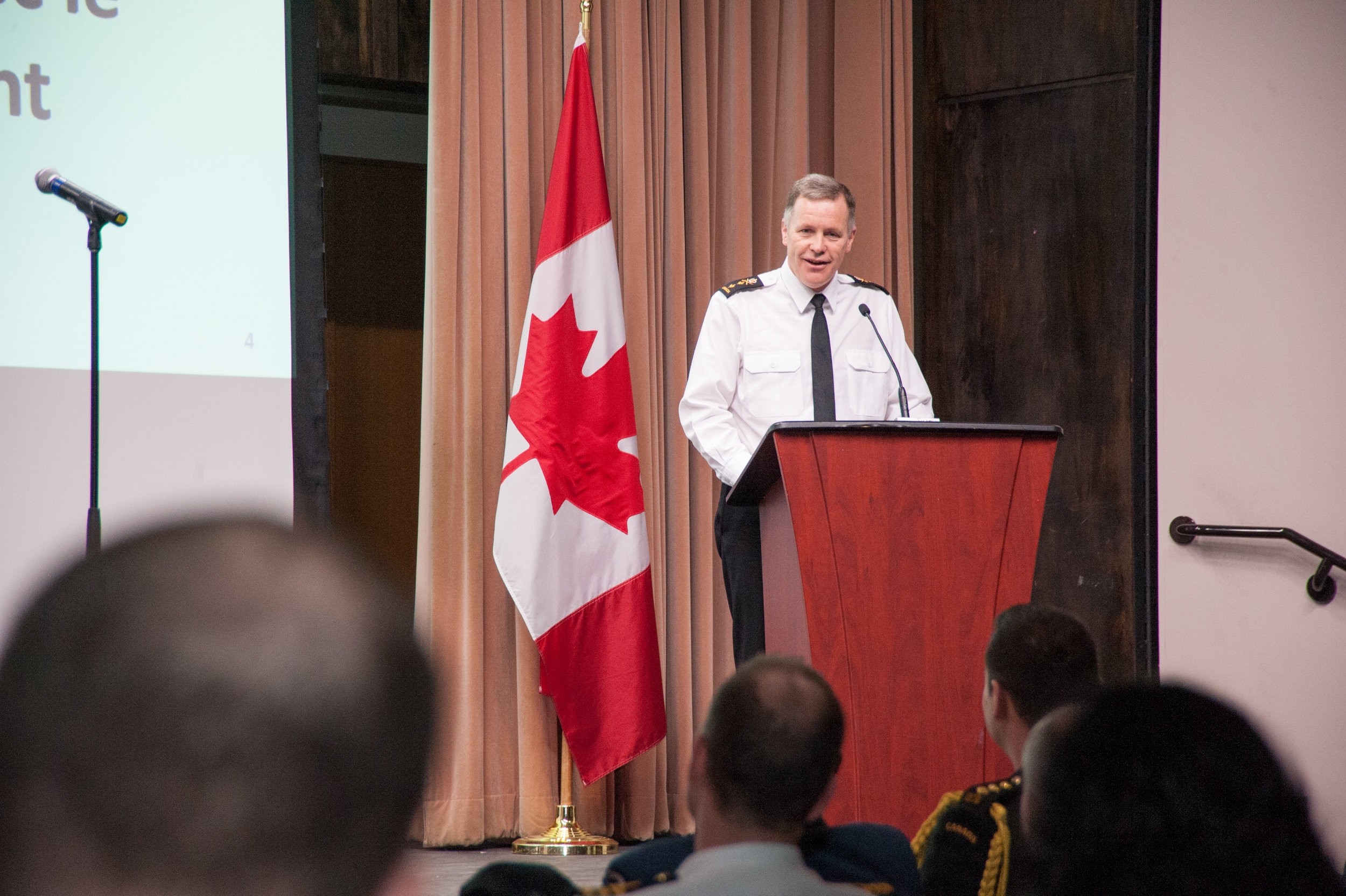Rear-Admiral Scott Bishop addresses members of the Canadian Forces Intelligence Group. Serving his country since 1983, Bishop was appointed Commander of the Canadian Forces Intelligence Command and Chief of Defence Intelligence in June of 2016. Prior to taking the helm of CFINTCOM, he commanded both the Pacific and Atlantic fleets. (dnd)