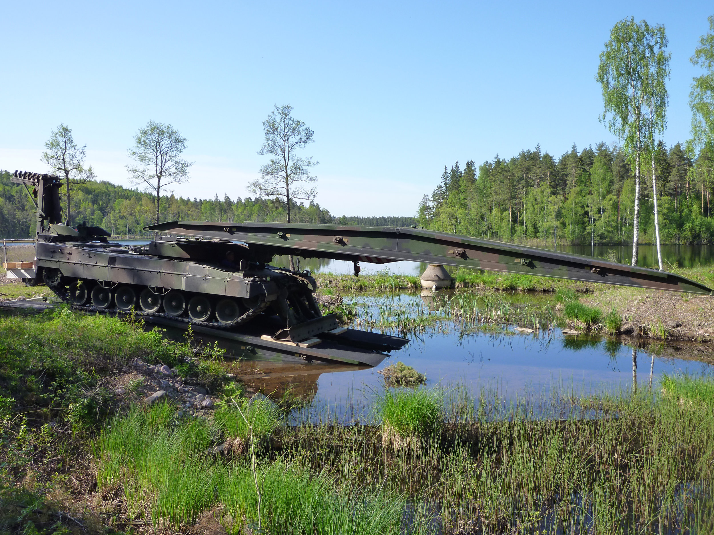 In 2008, Krauss-Maffei Wegmann introduced the Leguan, a new bridge laying system that can be mounted on the chassis of either Leopard 2 main battle tanks (pictured) or carried by a variety of wheeled vehicles. Leguan has horizontal (cantilever-type) launching, automatic launching within a few minutes, one-man and two-man operational abilities and an integrated test system. (all photos courtesy of krauss-maffei wegmann)