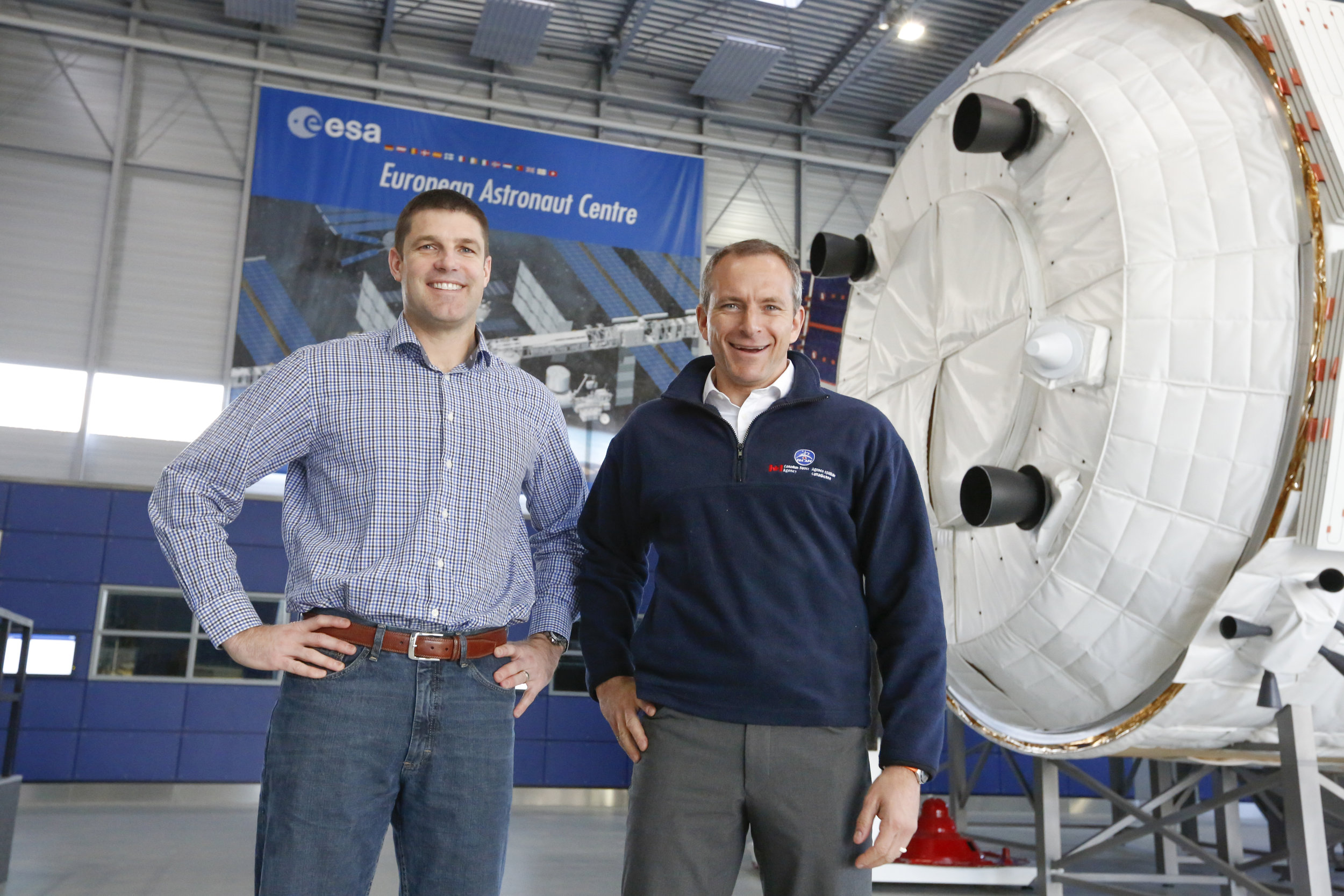 Canadian Space Agency astronauts Jeremy Hansen and David Saint-Jacques in front of the Columbus simulator, at the European Space Agency, where they received training on January 18, 2016, on how to operate the Columbus laboratory, which is attached to the International Space Station. (ESA/Sabine Grothues)