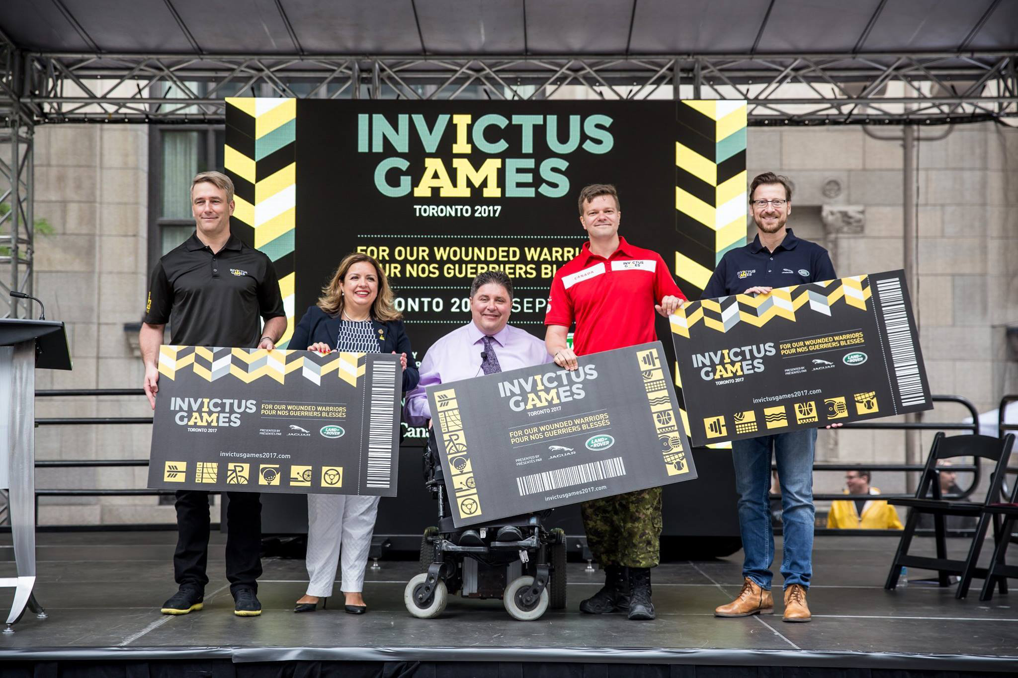 Veterans Affairs Minister Kent Hehr (centre) announced the federal government's $17.5-million contribution to the Games at the ticket launch on June 15. Also at the event were TPL co-founder Michael Burns (left), co-captain of the IG17 Team Canada, Maj Simon Mailloux (second from right), and other sponsors such as Jaguar Land Rover.