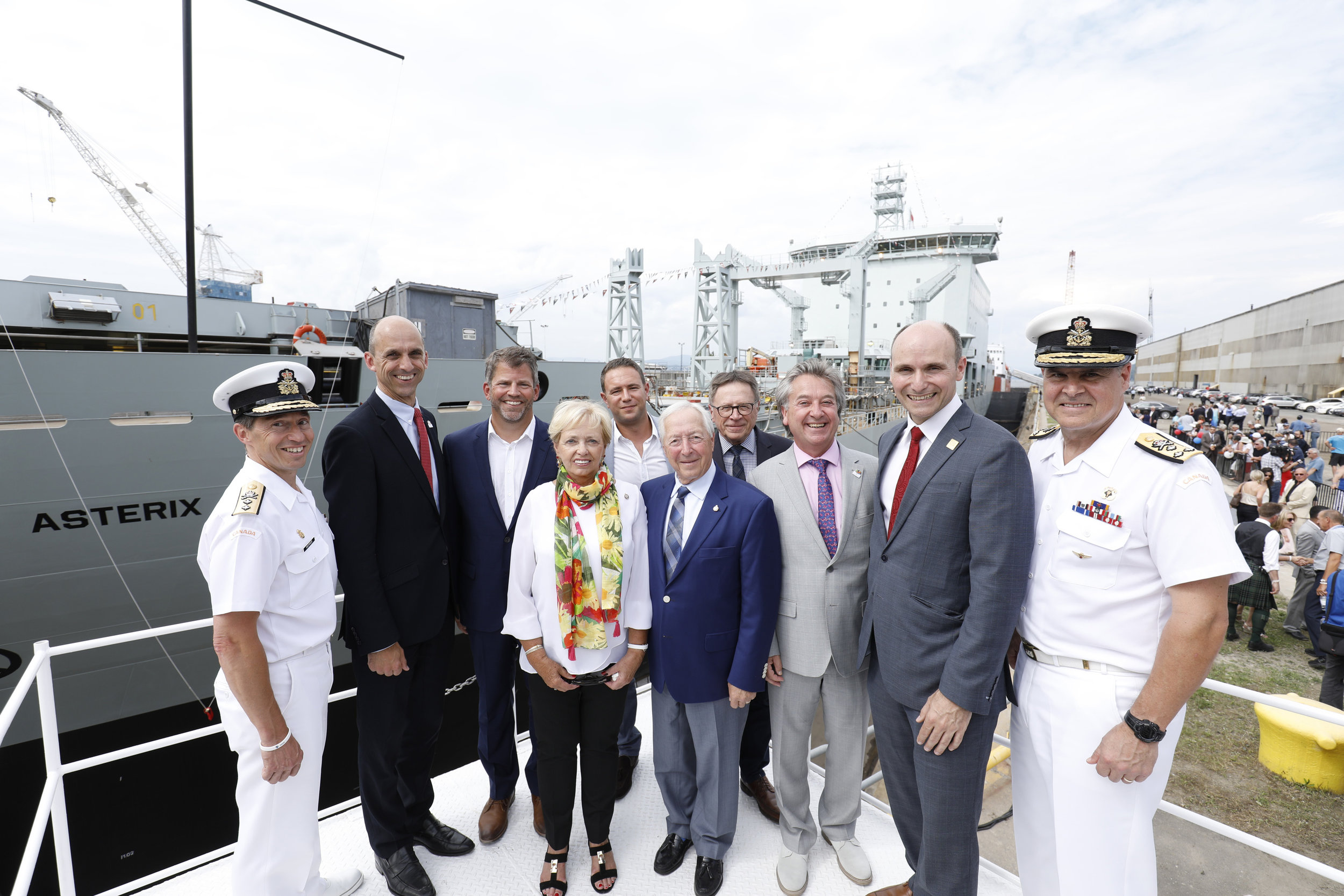 Thousands were on hand at the Chantier Davie shipyard in Lévis, Quebec to watch Canadian naval history in the making with the unveiling on July 20 of the Resolve-class Asterix — it is the first time a commercial vessel has been converted to conduct refuelling and resupply operations for the Canadian Armed Forces. Among those in attendance were RAdm Gilles Couturier, Steven Blaney, Spencer Fraser, Pauline Théberge, Alex Vicefield, Jacques Létourneau, Jean D'Amour, Gilles Lehouillier, Jean-Yves Duclos, and VAdm Ron Lloyd. (chantier davie)