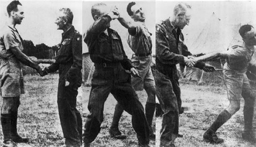 "Major William Fairbairn demonstrates how to disarm and counterattack an enemy at Camp X in July 1942. Fairbairn was Camp X's expert on silent killing and the man in charge of teaching ""ungentlemanly"" techniques to the Special Operations Executive (SOE) — the secret agents who supported resistance movements in enemy-occupied countries."