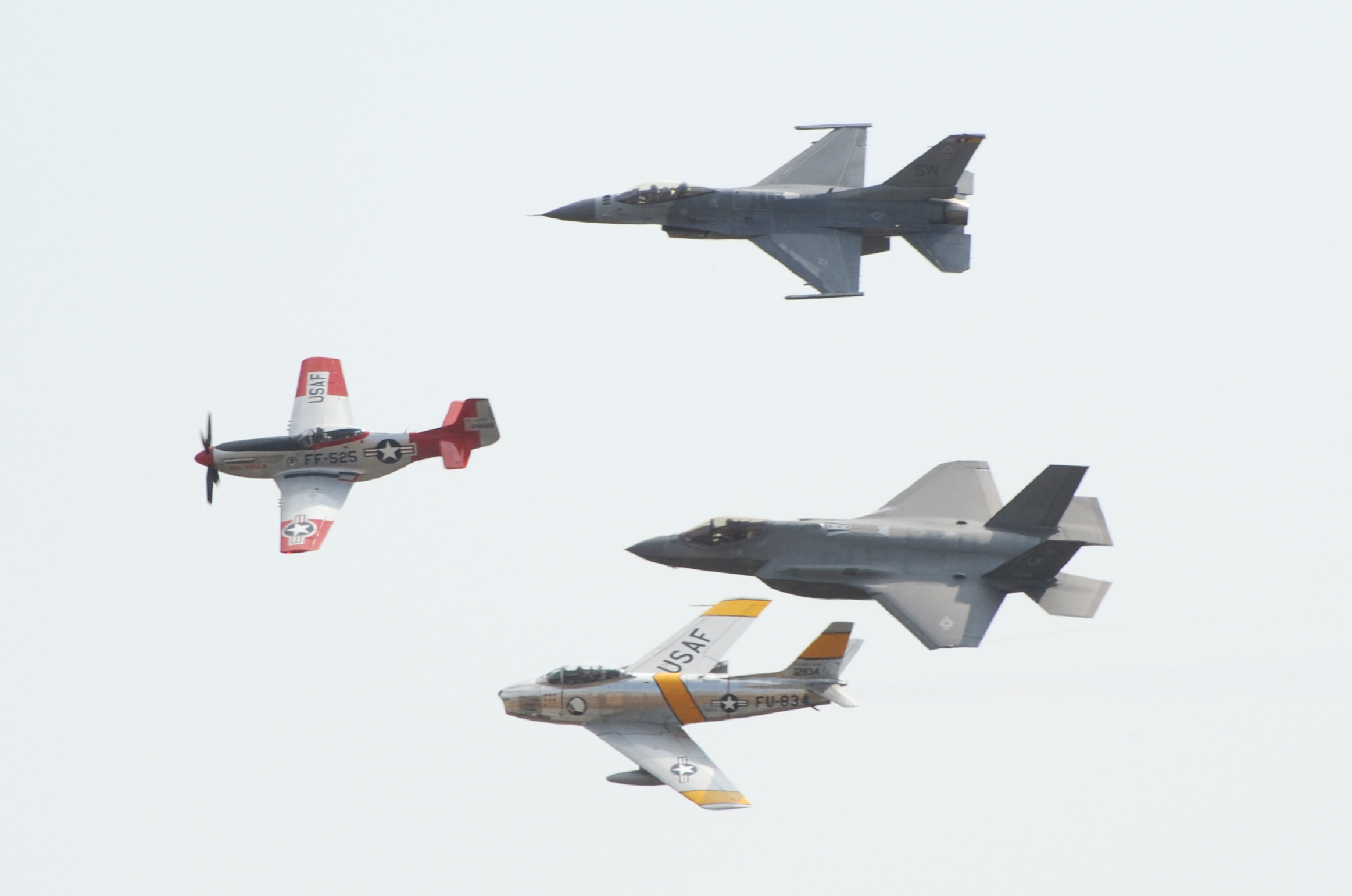 "A USAF ""Heritage Flight"" at Abbotsford Air Show included (top to bottom) the F-16 Fighting Falcon, P-51 Mustang, F-35, and F-86 Sabre."