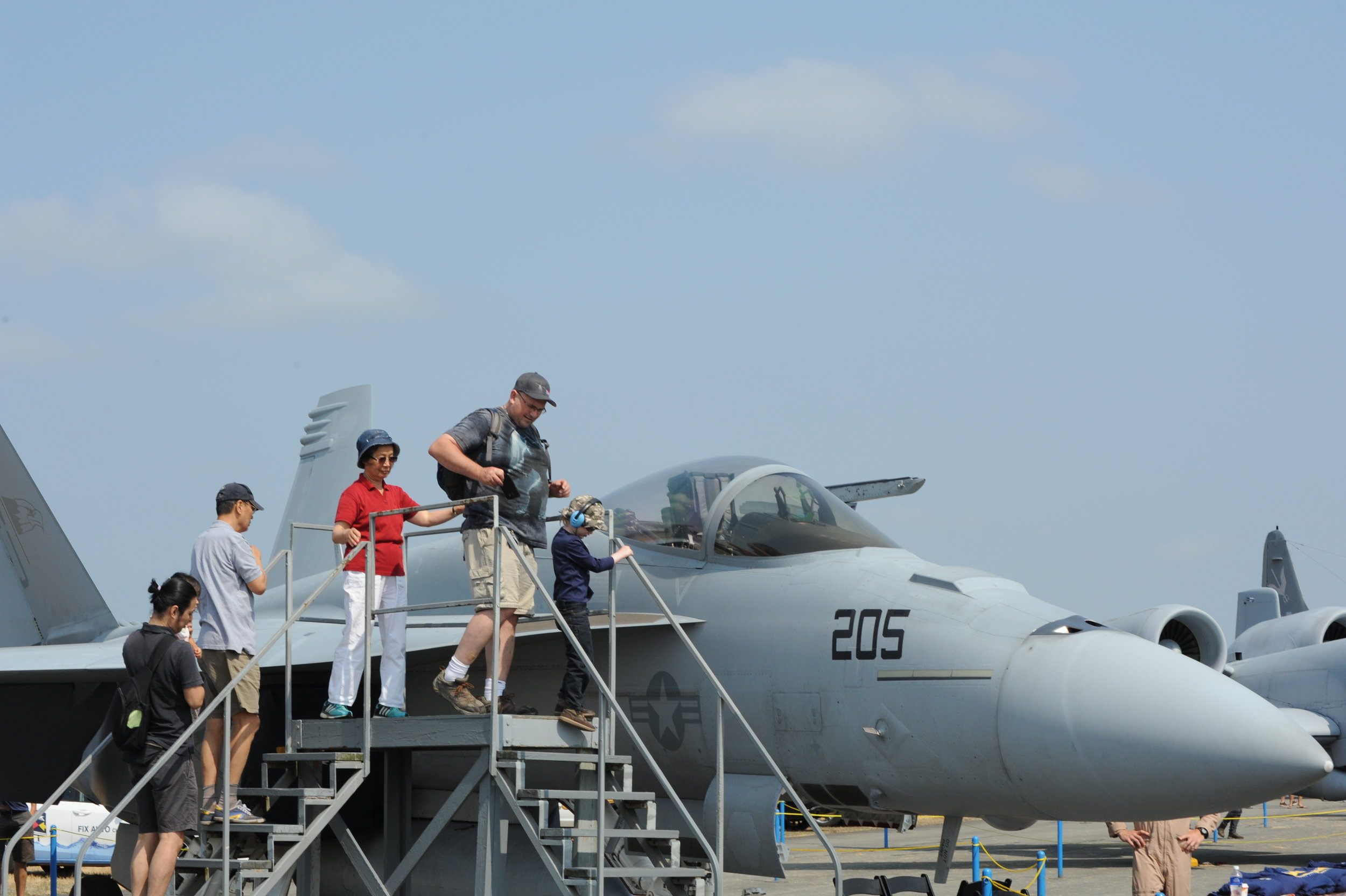 Visitors at the Abbotsford Air Show lined up to get a close-up view of the inside of a USAF Boeing Super Hornet cockpit. (photos courtesy of mark pugliese     &     david pugliese)