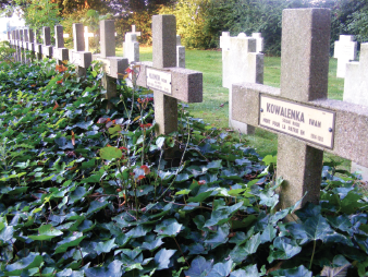 "Russian POW graves are carefully tended by their German overseers, and strike a contrast between the plain German war graves. By the end of WWI, POWs in Germany totalled in the millions. The closest grave marker is for Iwan Kowalenka, a Russian soldier, who died fighting for France (""mort pour la patrie"") in 1914–1918."