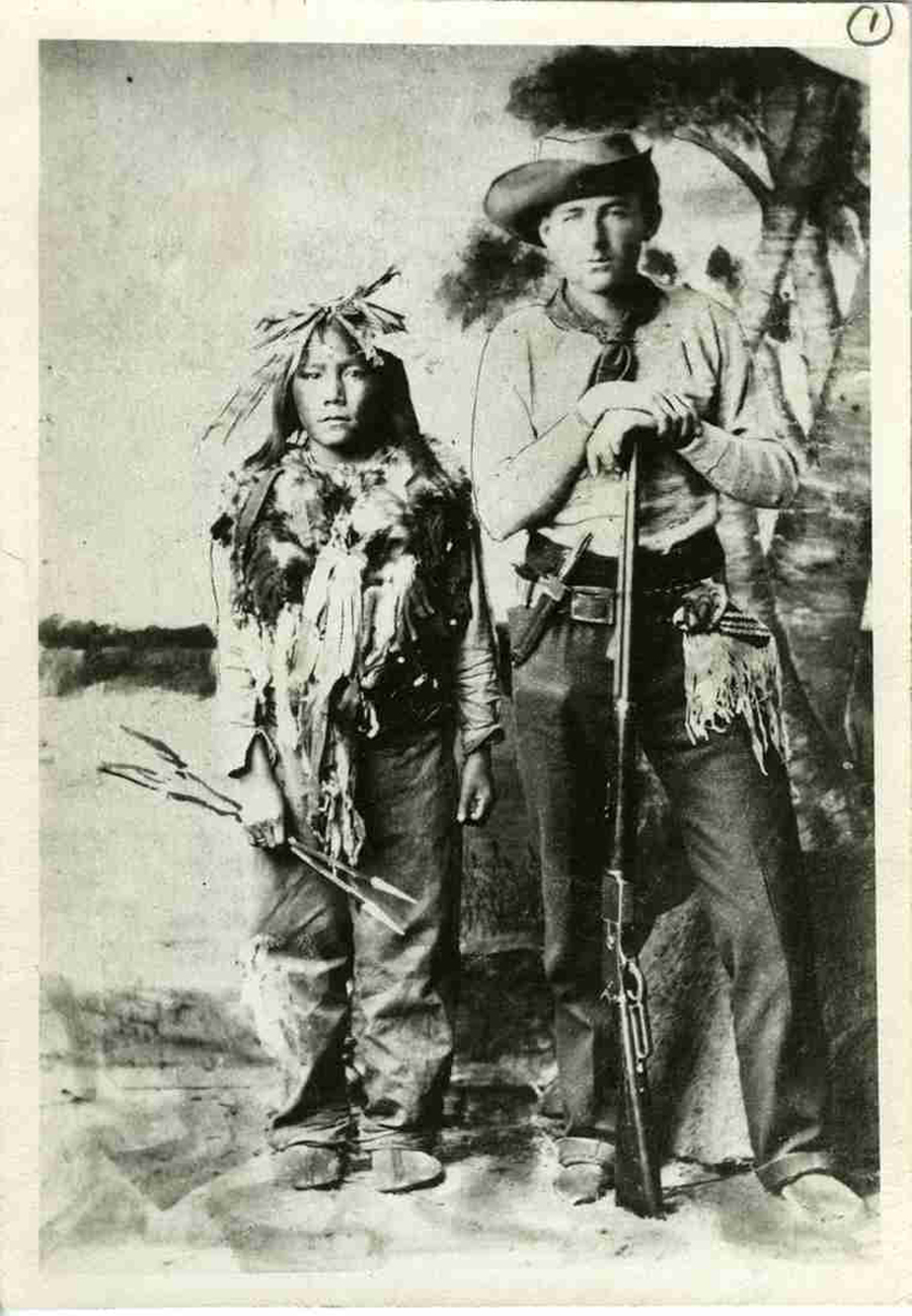 Horse Child (left), Big Bear's 12-year-old son, with Hudson's Bay Company clerk William Bleasdell Cameron, who survived the Frog Lake Massacre. During Big Bear's trial, when this photograph was taken, Cameron testified in the old chief's defence. (saskatoon public library, local history room)