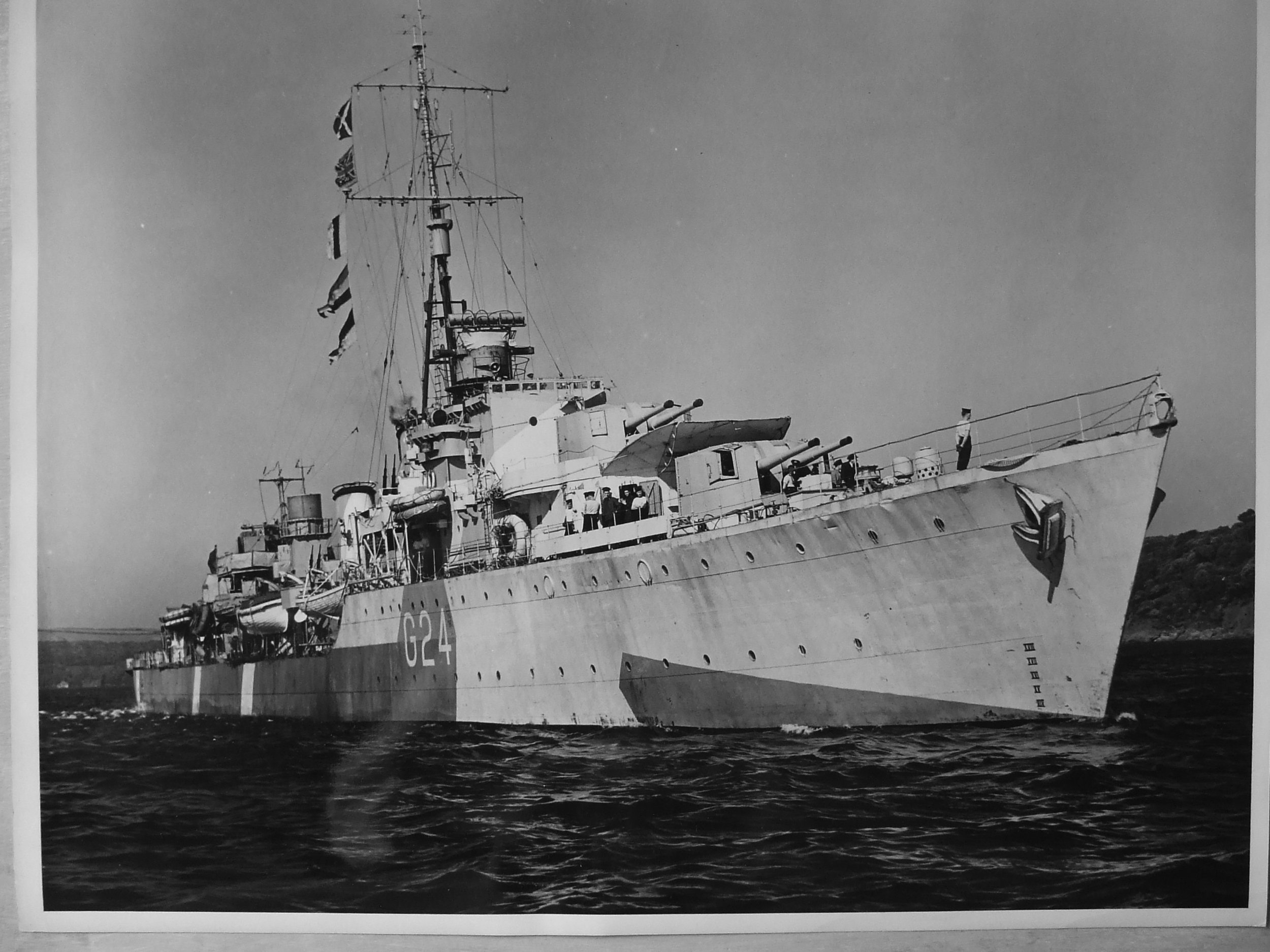 The Royal Canadian Navy's HMCS  Huron  (G24), in dazzle camouflage, sailing out to sea during the Second World War during one of her countless trans-Atlantic escorting runs. The Tribal-class destroyer, commissioned on July 28,1943, also served in the Pacific theatre during the Korean War under the new pennant number 216.