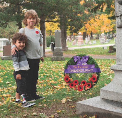 Myles Newton (left) and Ryley McMillan (right) laying a wreath on behalf of The War Amps.