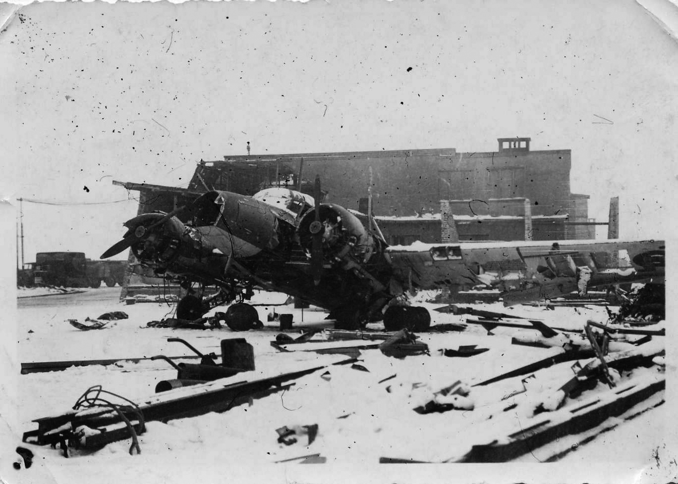 The destroyed airfield and fighters of No. 403 Squadron at Evere, January 1, 1945. Germany's Operation BODENPLATTE called for a surprise attack against 16 Allied air bases in Belgium, the Netherlands and France, resulting in the destruction or crippling of as many aircraft, hangars and airstrips as possible. (john le may)