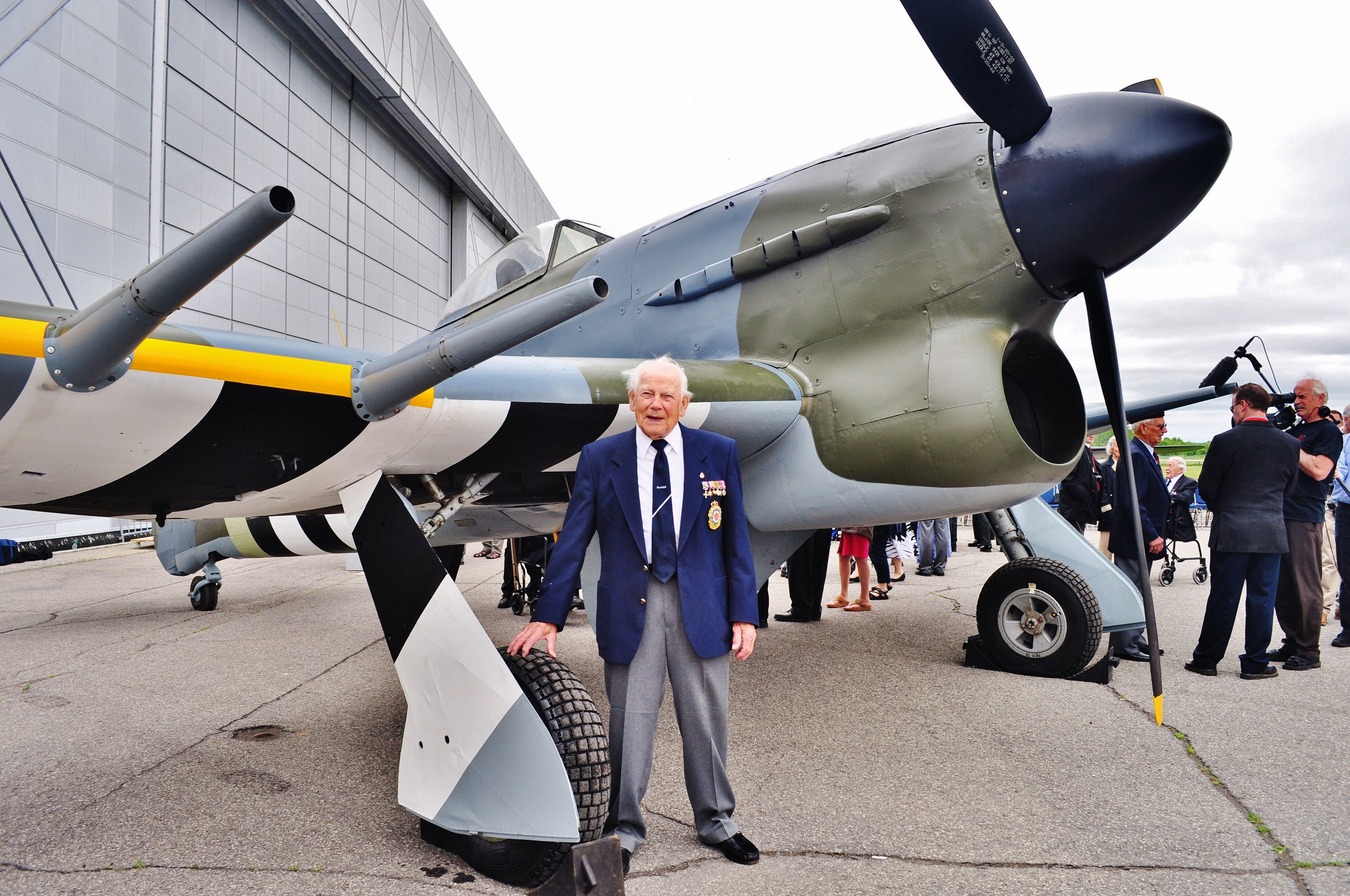 "Bob Spooner, photographed before an authentic Hawker Typhoon in Ottawa in June 2014, was with No. 438 Squadron when the base at Eindhoven was hit. BODENPLATTE was nickname ""The Hangover Raid,"" as many were suffering the morning-after effects of ringing the New Year when the German fighters launched their surprise attack that morning. (rod spooner)"
