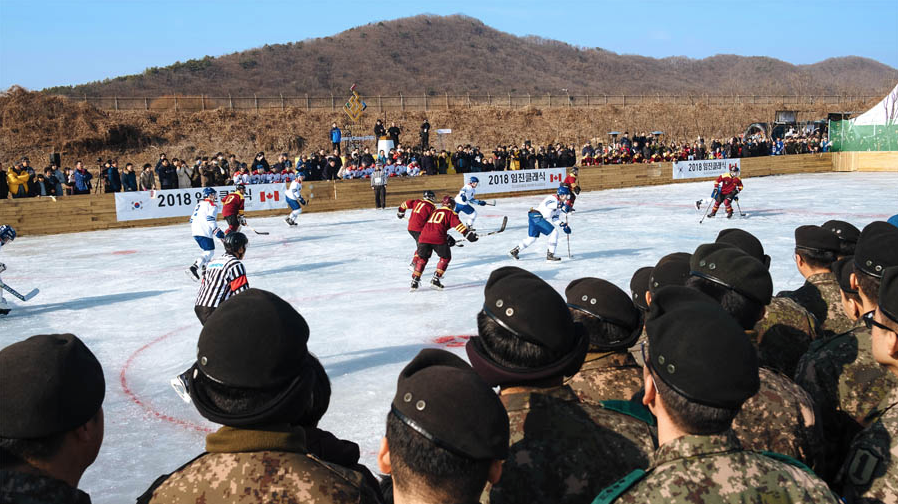 """Korean Army members attentively watch """"Team Canada"""" made up of members of Princess Patricia's Canadian Light Infantry and Royal 22e Régiment, and Canadian expats as they take on """"Team Corea"""", made up of players from Yonsei University and Korea University in Paju City, South Korea on January 19, 2018. Photo: Dylan Goldby, WelkinLight Photography"""