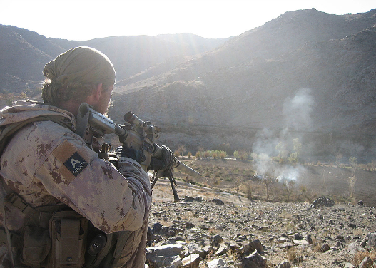 A Canadian Special Operations Forces (CANSOF) soldier looks to the valley below during a 2011 mission in Chenartu, Afghanistan. CANSOF personnel are trained to conduct high-risk operations in hostile or politically sensitive areas. (dnd photo)