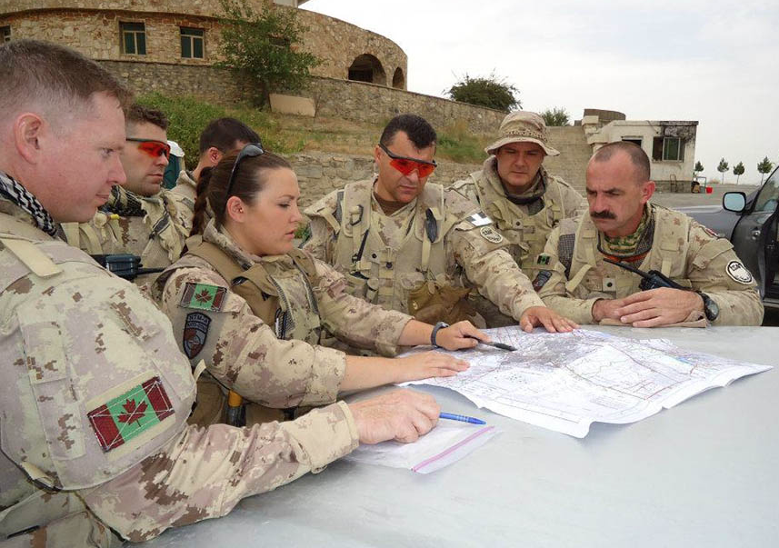 Captain Gillian Dulle (centre), in October 2011 in Kabul, Afghanistan. The group is part of the Operation ATTENTION Roto 0 who was mentoring the Afghan National Army at their staff college. Photo: provided by Major Gillian Dulle.