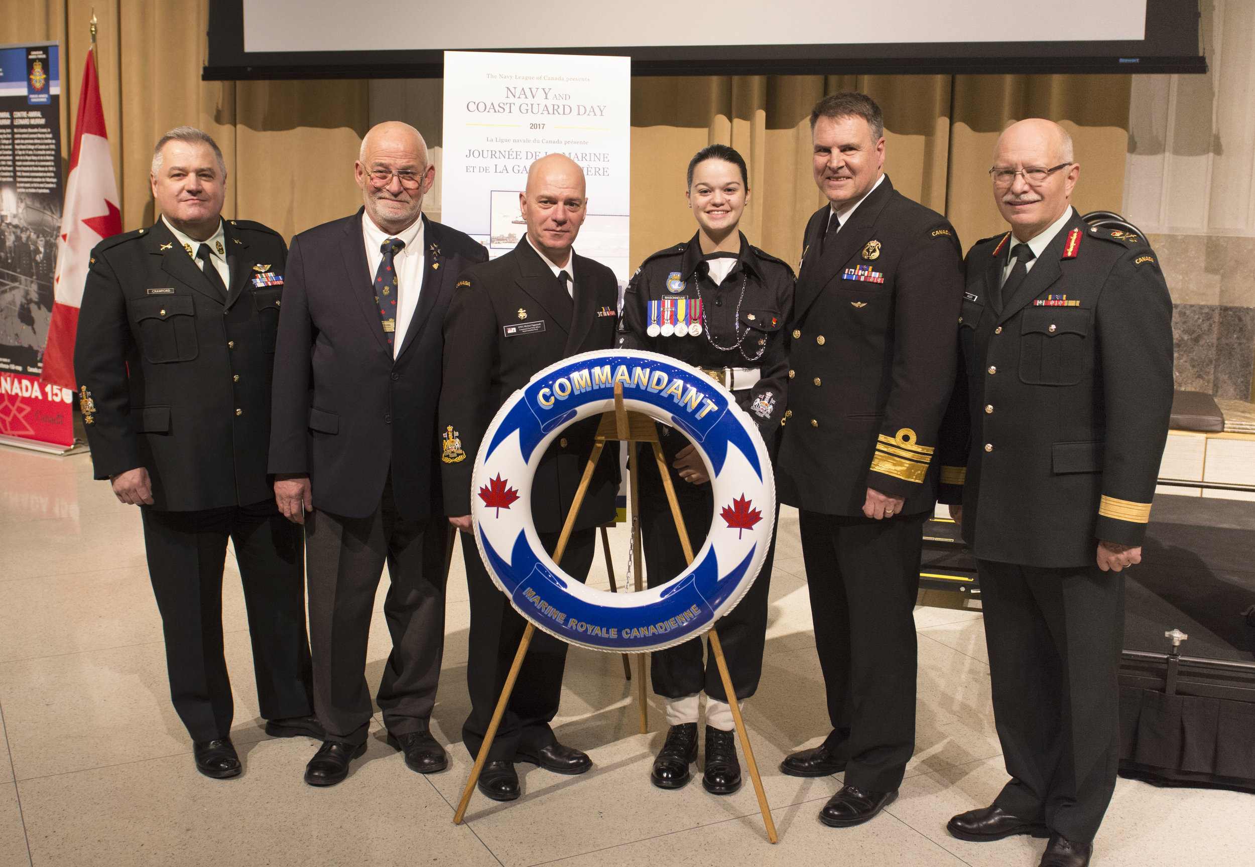 From left to right: Chief Warrant Officer Bill Crawford, Earle Corn, Chief Petty Officer of the Navy Michel Vigneault, Chief Petty Officer First Class Maude Maisonneuve, Vice-Admiral Ron Lloyd and Brigadier-General Kelly Woiden after the official presentation of the Sea Cadet Centennial Pin during the Navy and Coast Guard Day in Ottawa on November 21, 2017. On this day, and in honour of her title of Sea Cadet of the Year, CPO 1 Maisonneuve was the only youth in attendance. (mcpl pierre habib, dnd)