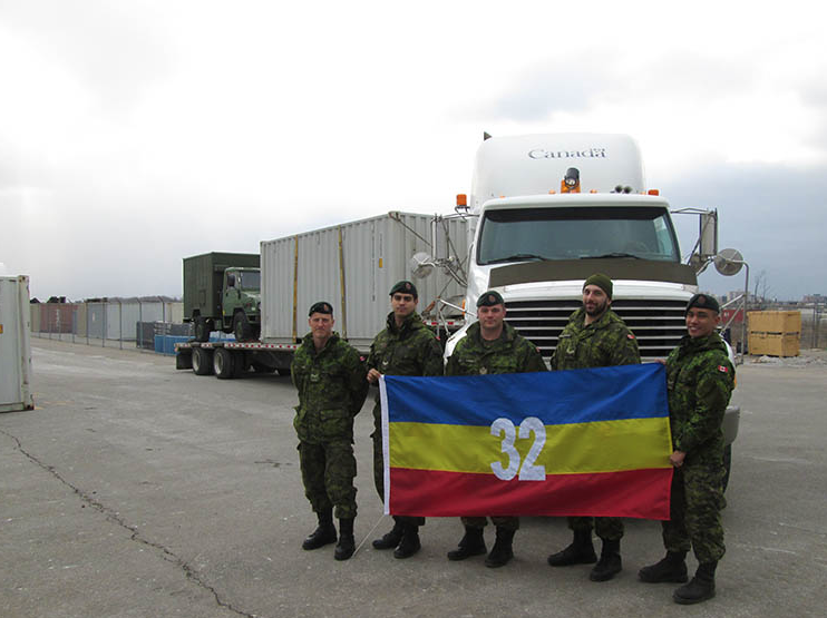32 Service Battalion members (left to right) Private Randy Avery, Corporal Emanuel Bustello, training instructor Sergeant Tim Canning, Corporal Artin Der Galstanian, and Private Gerald Abaca are part of a new and growing long-distance trucking team within the Canadian Army Reserves. Photo: provided by 32 Service Battalion. ©2018 DND/MDN Canada.