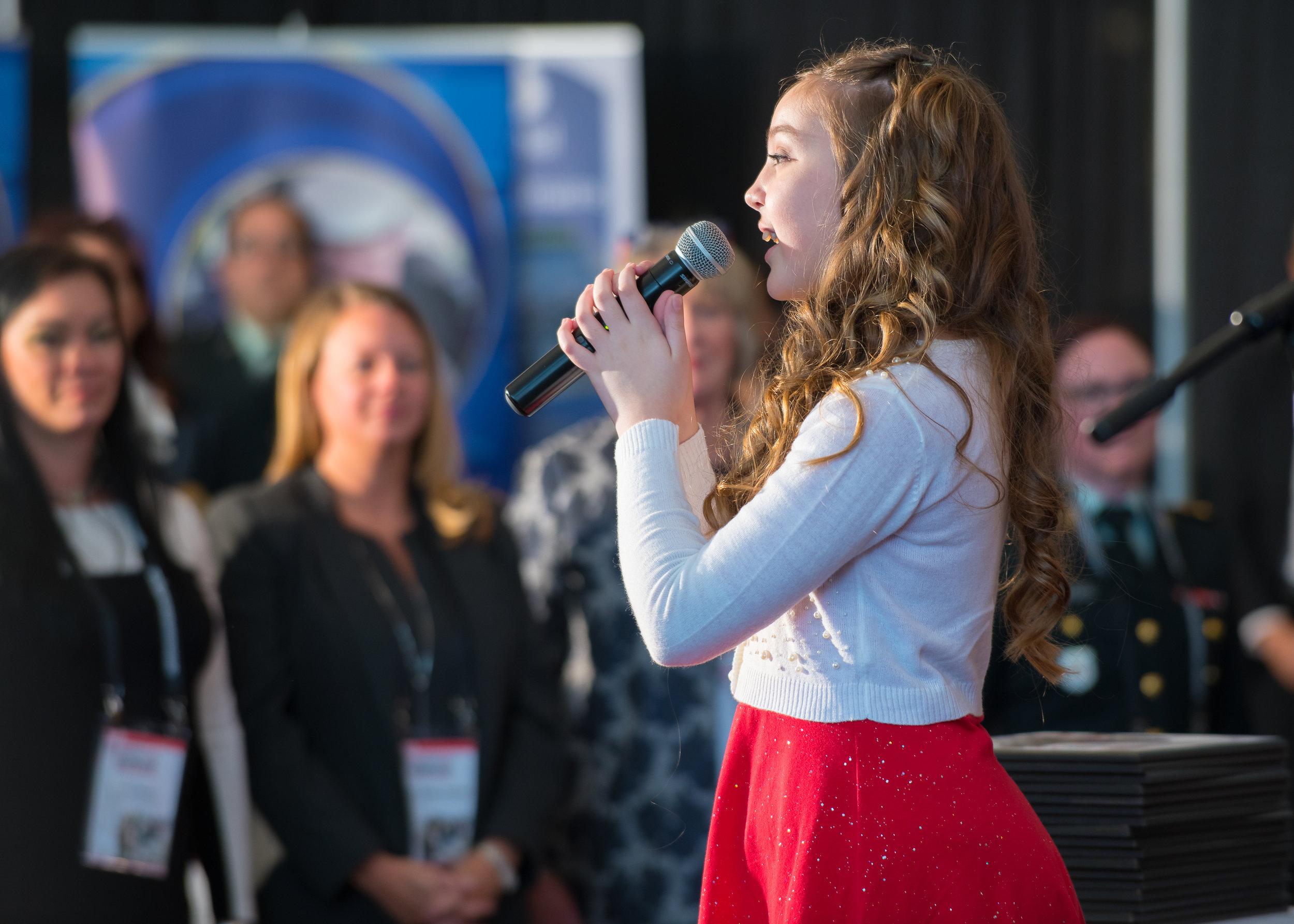 Mia Jovanovic sings the national anthem.