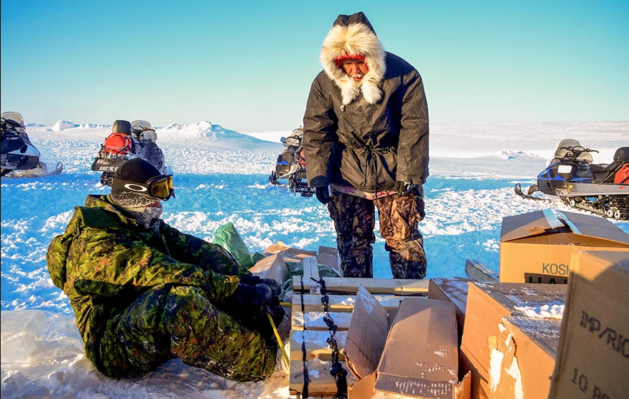 Members of 1st Canadian Ranger Patrol Group, deployed with the Arctic Response Company Group, prepare their qamutiiks before departing for a patrol in Resolute, Nunavut during Operation NUNALIVUT on March 8, 2018. Photo: Petty Officer Second Class Belinda Groves, Task Force Imagery Technician. ©2018 DND/MDN Canada.