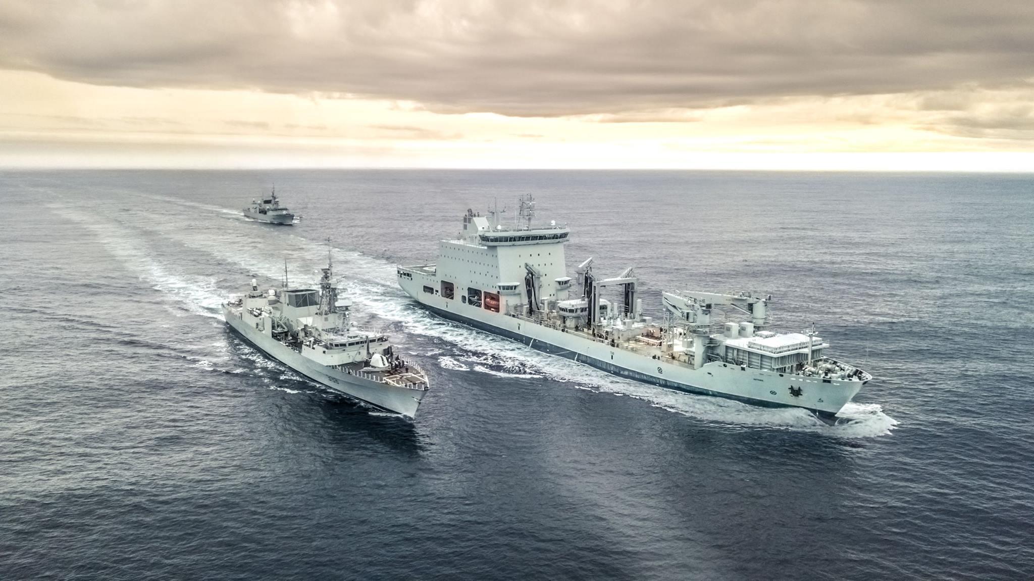 The MV Asterix, Davie's new naval replenishment unit (NRU) sails the Atlantic Ocean with HMCS Toronto and HMCS Montreal. The vessel is conducting a replenishment at sea off the coast of Halifax, Nova Scotia on January 17, 2018. (jeremy citone, chantier davie canada)