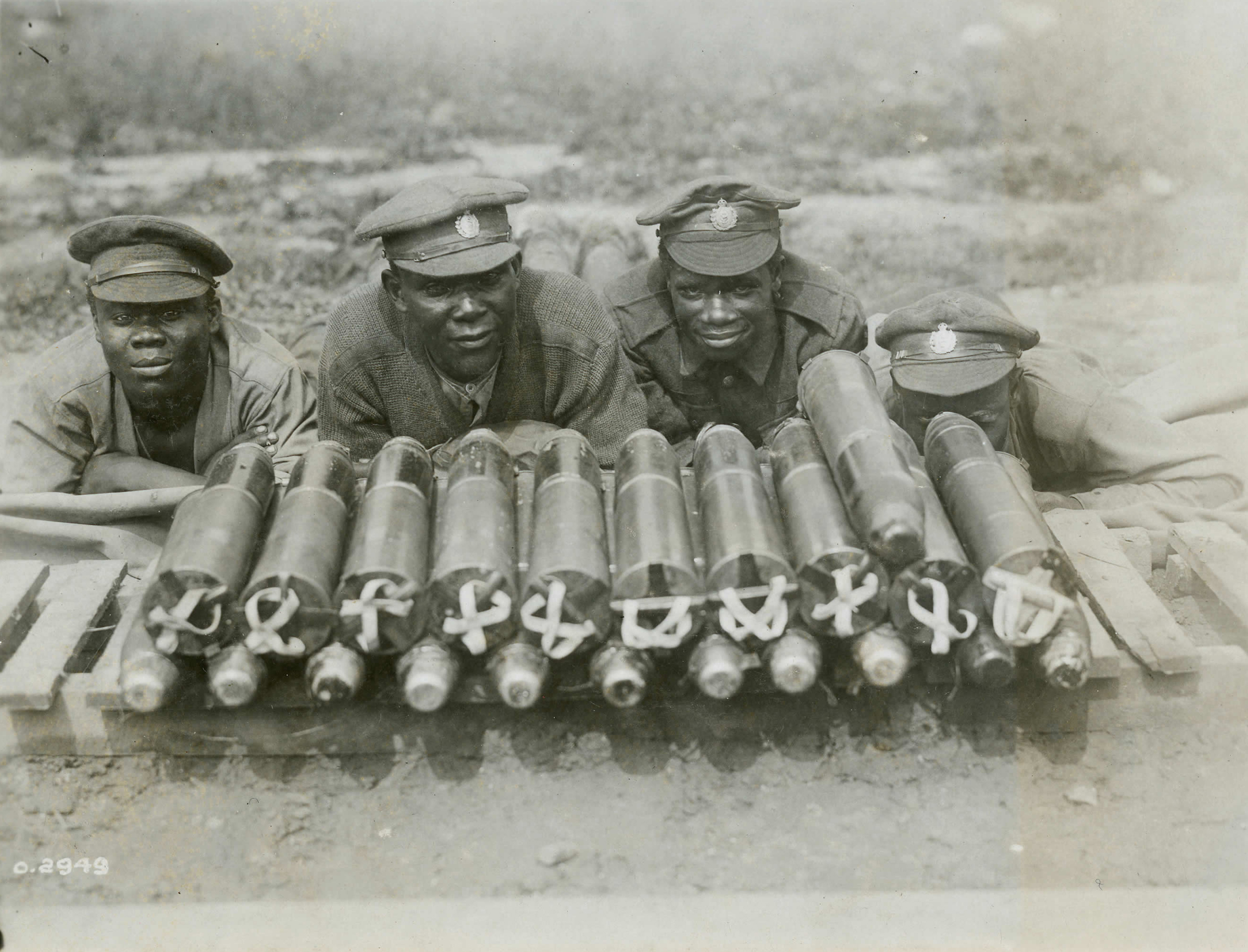 African Canadians pose with ammunition before loading it into tramway cars to be taken up the line. Most black soldiers who served in the Canadian Expeditionary Force remained segregated in labour units. Few were allowed to serve in combatant roles. (library and archives canada)