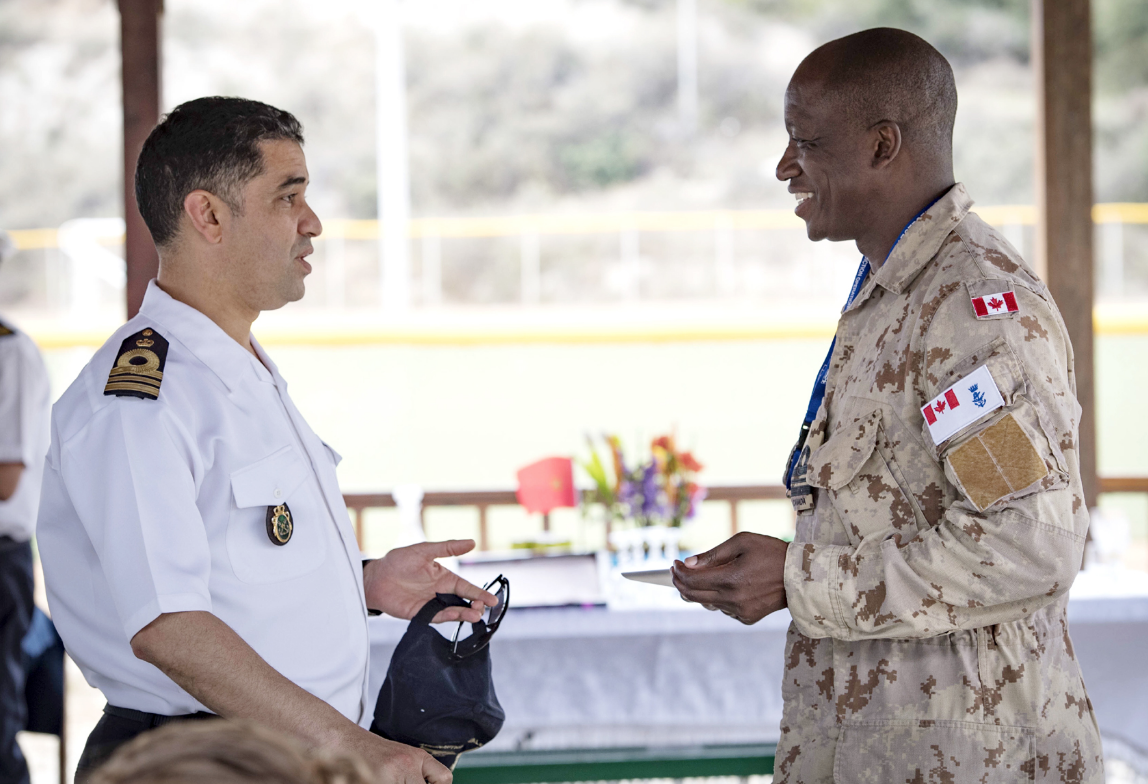 LCdr Paul Smith meets with LCdr Faissal Erraji of the Royal Moroccan Navy during PHOENIX EXPRESS 2018 in Souda Bay, Greece.