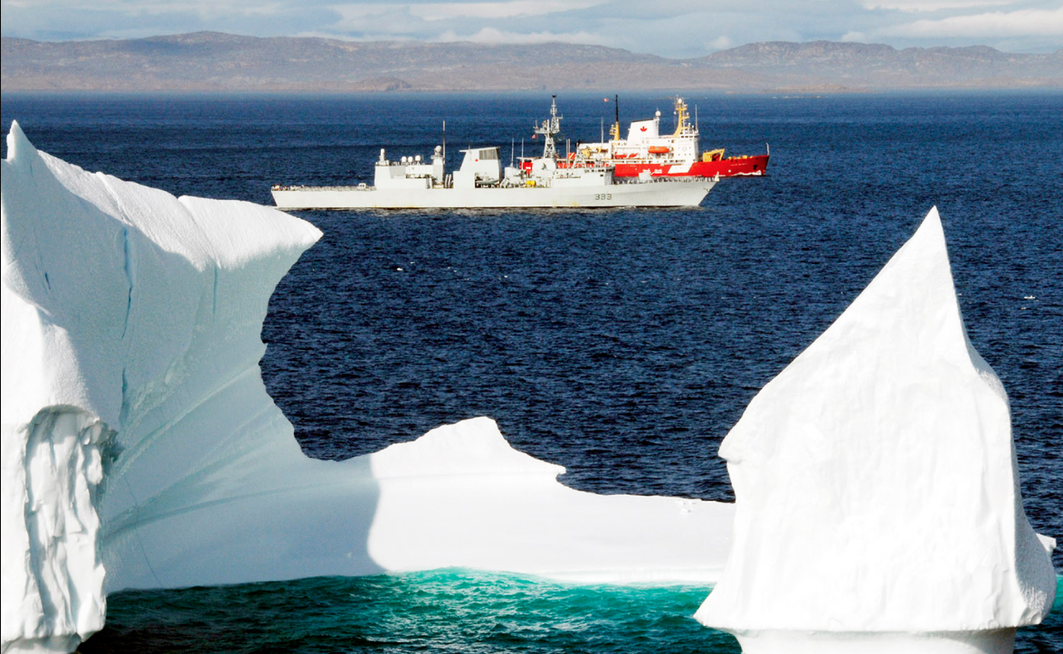 HMCS Toronto and Canadian Coast Guard Ship Pierre Radisson sail past an iceberg off the coast of Baffin Island during a past visit to Canada's North.