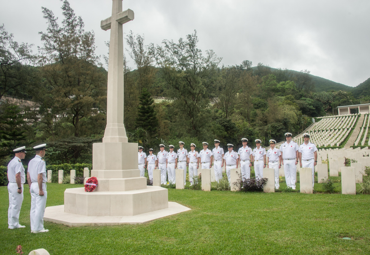 The Commanding Officer of HMCS Vancouver, Commander Christopher Nucci, accompanied by Coxswain Chief Petty Officer 1st Class Steve Wist, lay a wreath at the Cross of Sacrifice at the Sai Wan War Cemetery.