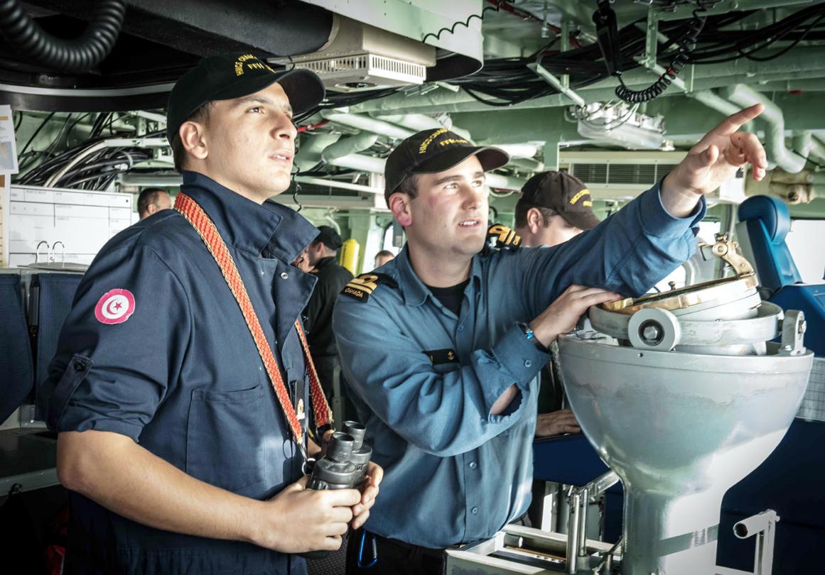 Sub-Lieutenants Ala Majdoub, left, and Hugo Brisson on the bridge of HMCS Charlottetown during Op NANOOK 2018.