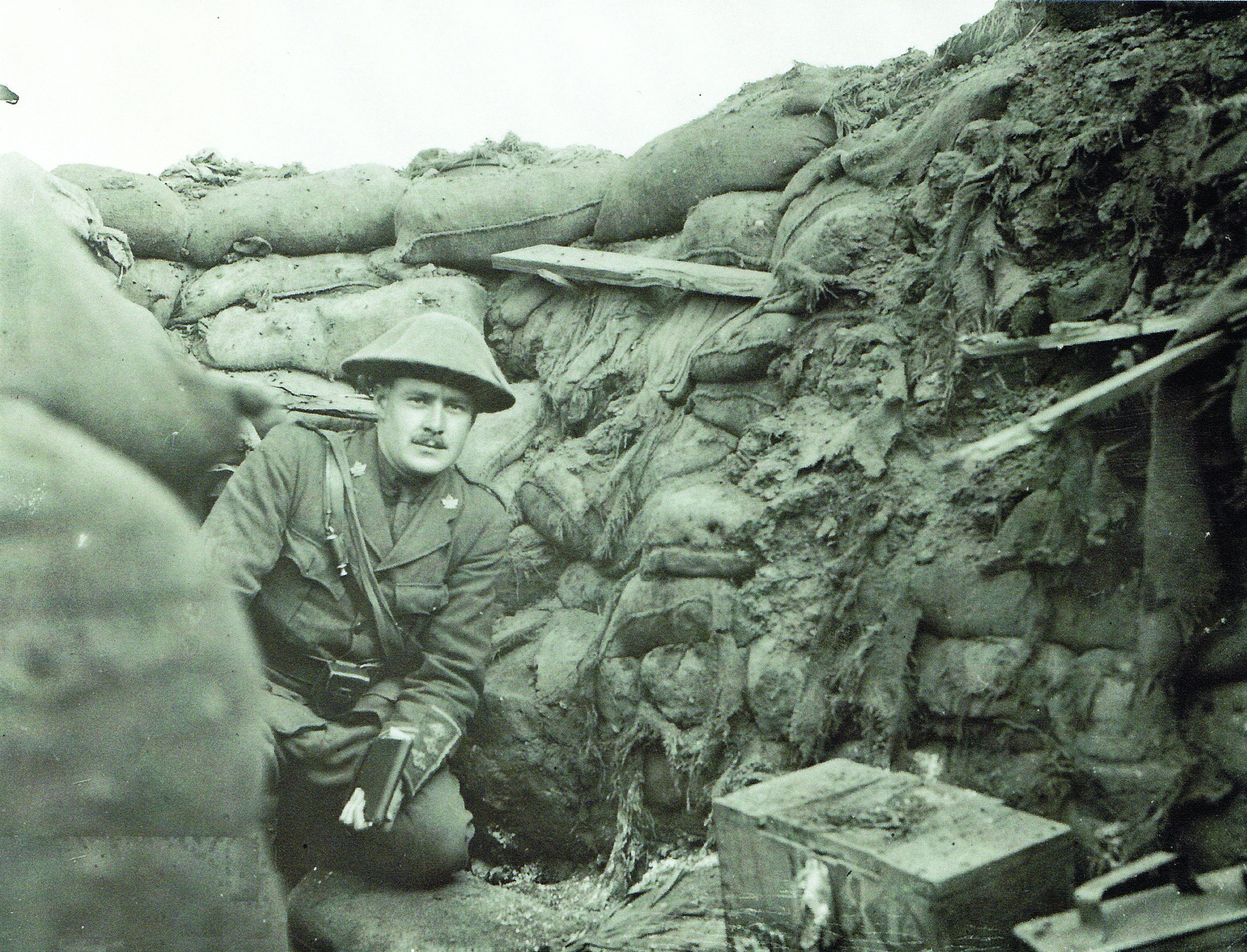 The Great war was an endless nightmare of mud and death fought over ditches and landscape features that barely rated proper names. (Above) Captain Peter Francis Fleming,   60th BN in an advanced post.   (LIBRARY AND ARCHIVES CANADA/NATIONAL DEFENCE/ 1964-114 PA-000584)