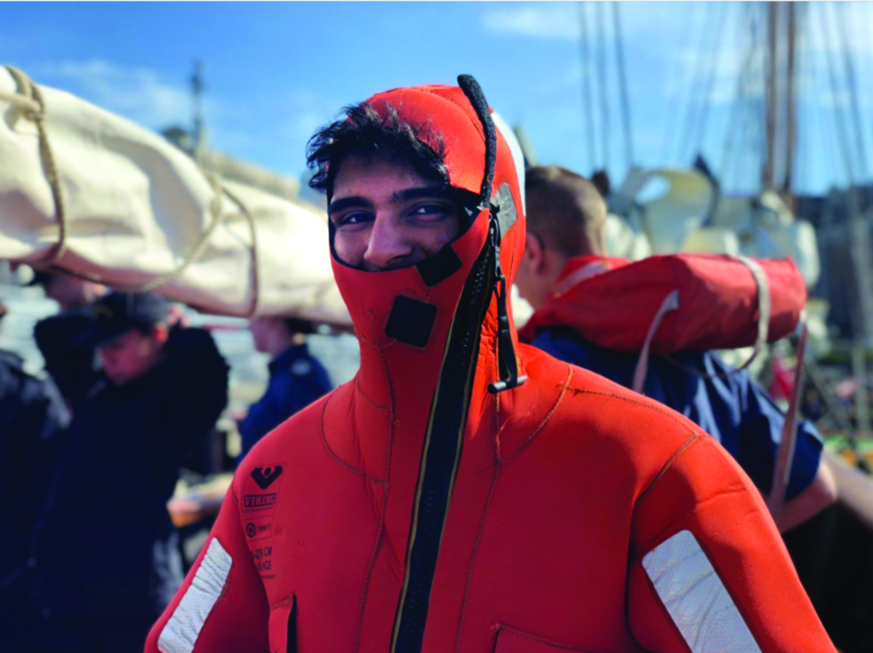 Cadet Pratik Menghani from Niagra Falls, Ontario tries on a wet suit and learns about survival at sea on Tall Ship Deployment 2018 off the coast of British Columbia. (Canadian Cadet Organizations)